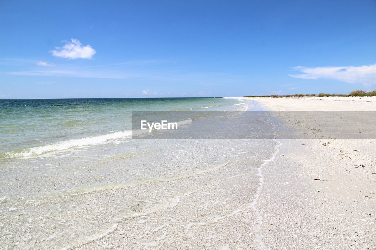 sea, beach, water, scenics, nature, sky, beauty in nature, tranquility, tranquil scene, day, horizon over water, outdoors, blue, sand, travel destinations, cloud - sky, no people, sunlight
