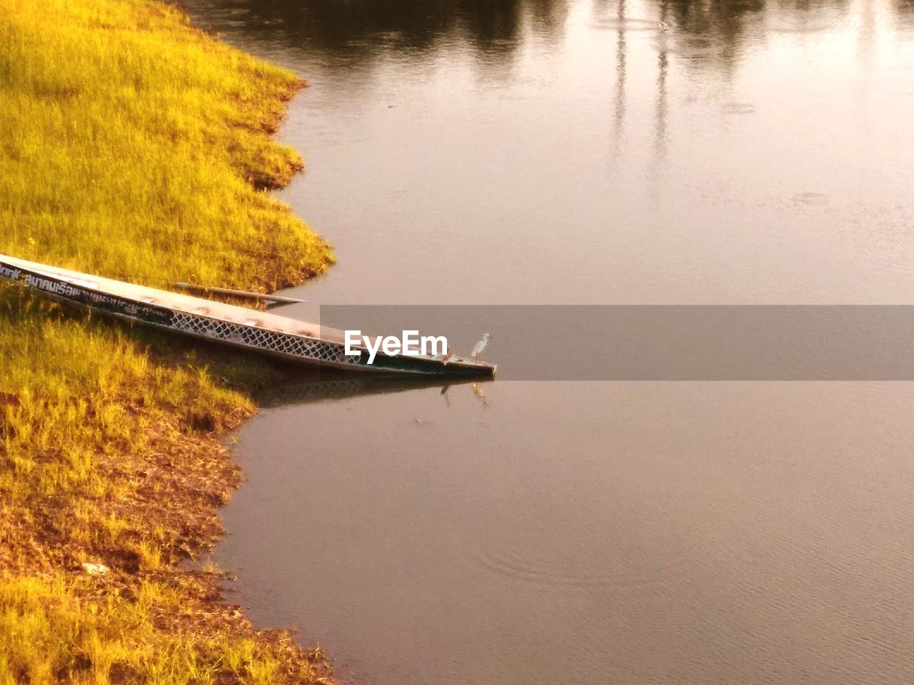 water, reflection, nautical vessel, no people, tranquility, nature, lake, high angle view, day, transportation, tranquil scene, beauty in nature, outdoors, waterfront, plant, mode of transportation, scenics - nature, non-urban scene