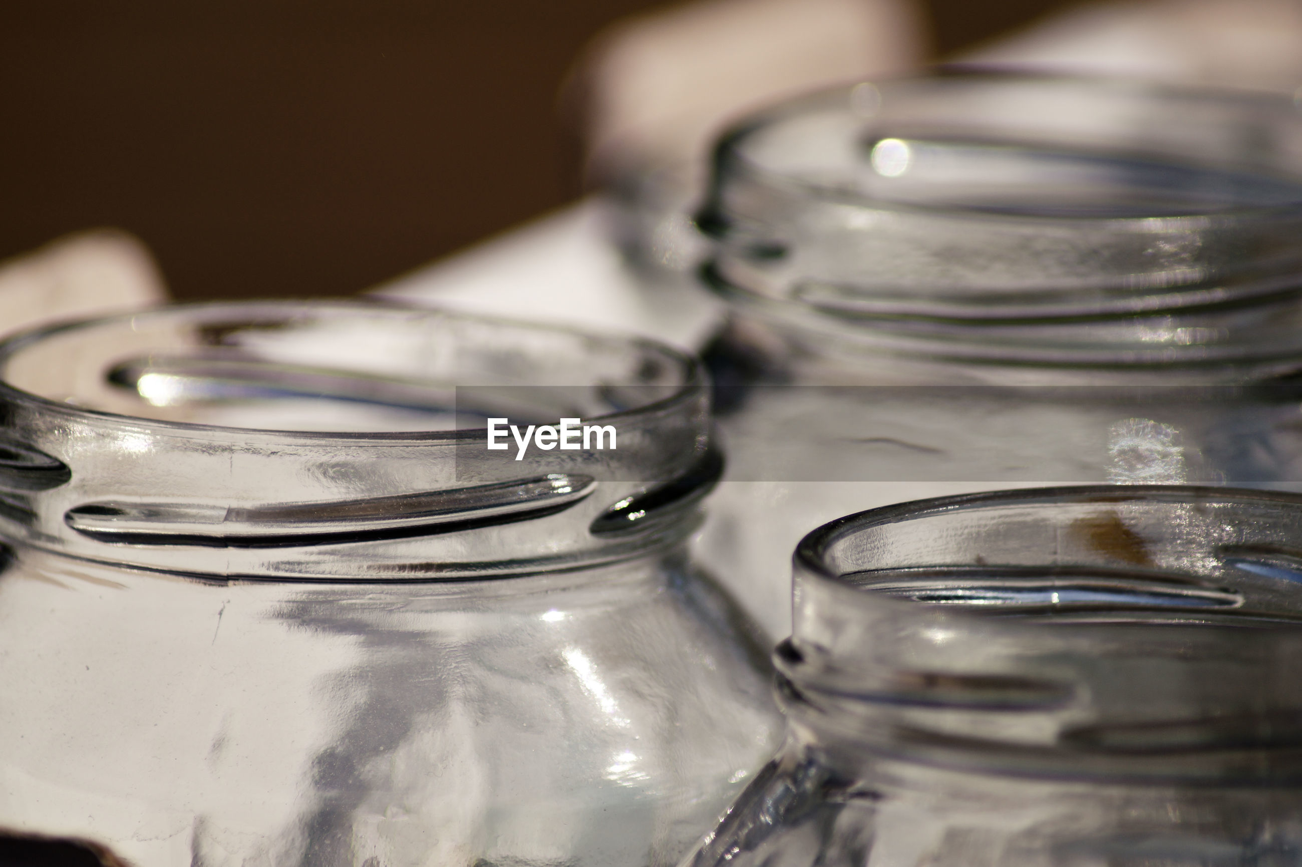 Close-up of open glass jars