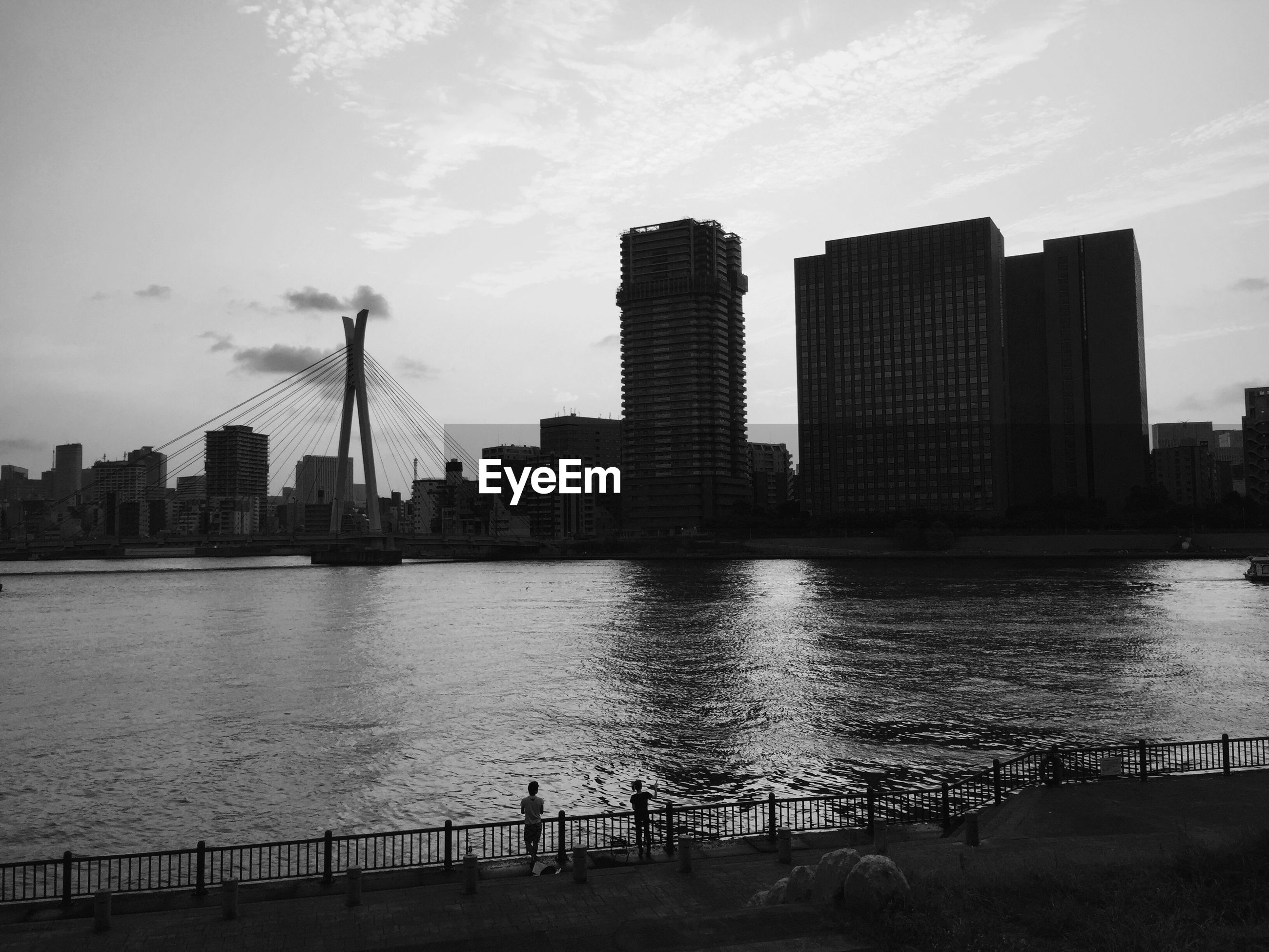 Scenic view of sumida river by buildings against sky