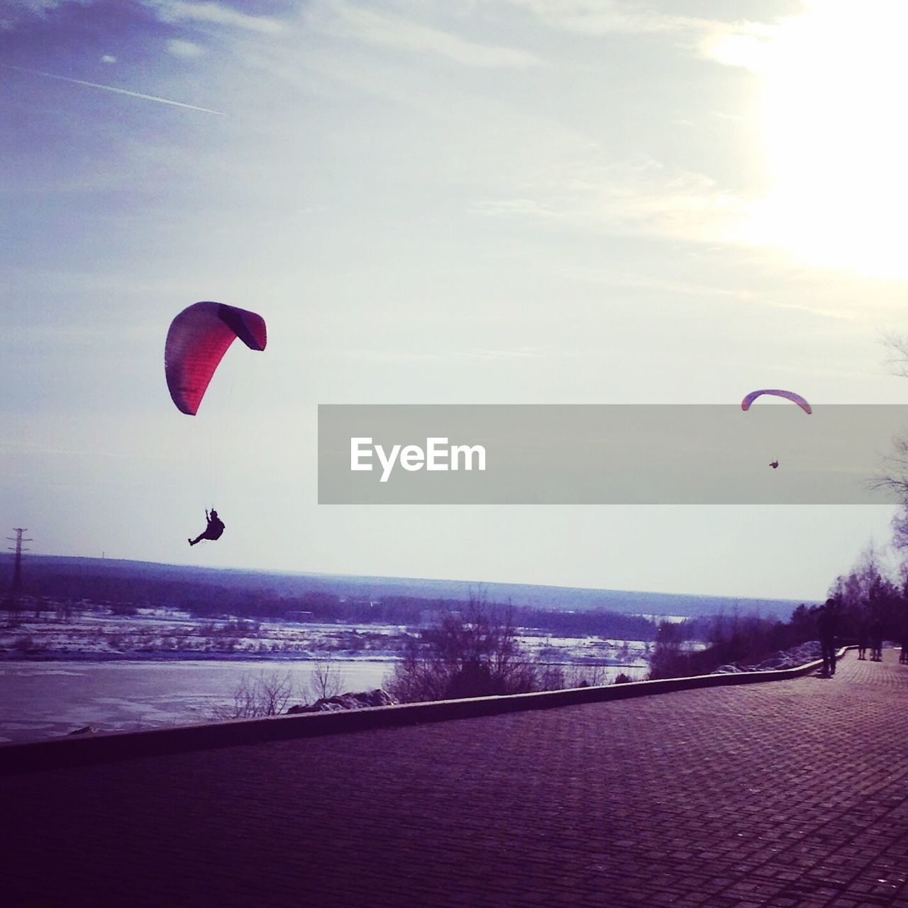 mid-air, adventure, nature, leisure activity, outdoors, sky, parachute, extreme sports, day, flying, real people, landscape, one person, paragliding, people