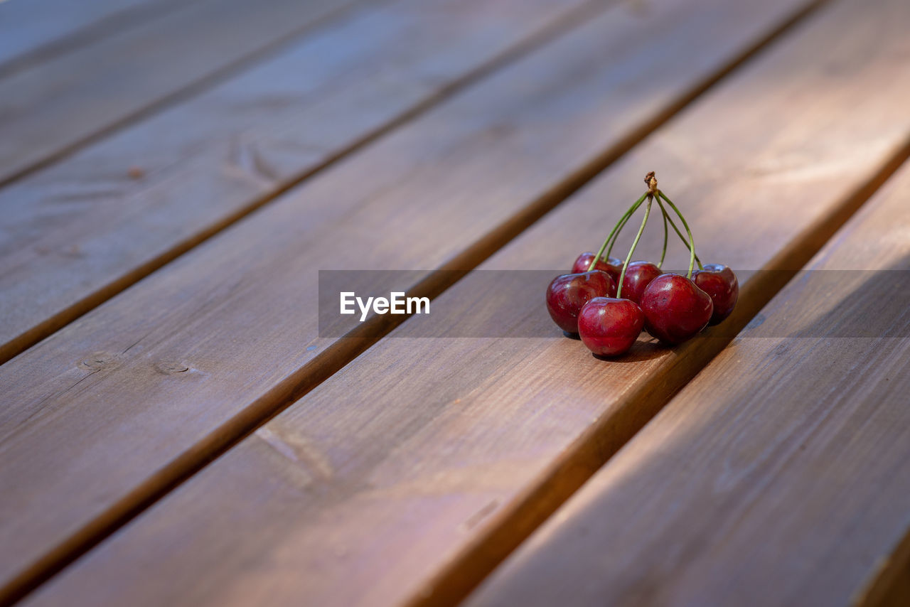 food and drink, healthy eating, food, wood - material, fruit, wellbeing, freshness, red, table, still life, close-up, selective focus, no people, vegetable, indoors, bench, day, nature, plant, cherry, ripe