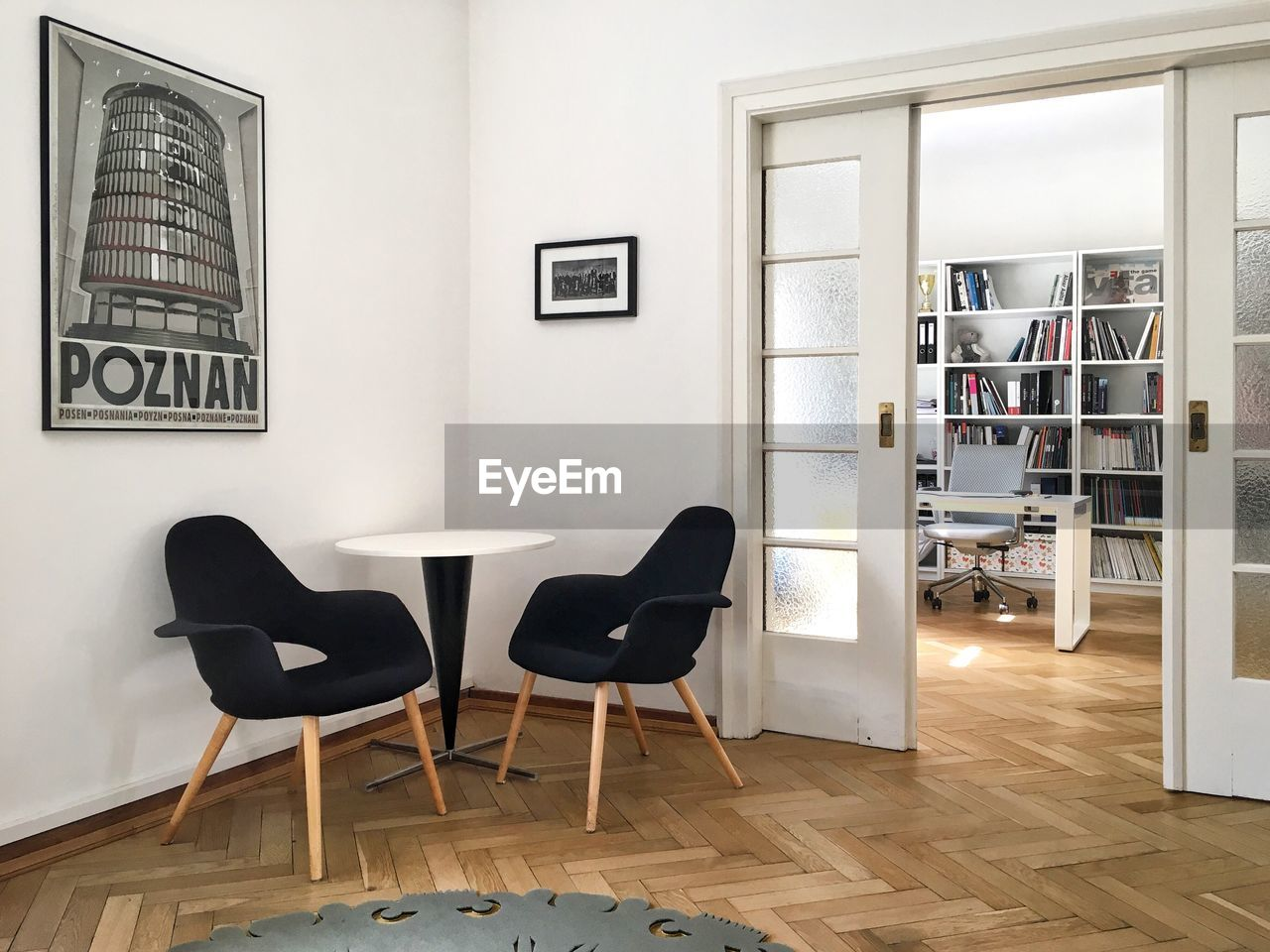chair, indoors, home interior, hardwood floor, table, architecture, no people, bookshelf, built structure, day, home showcase interior