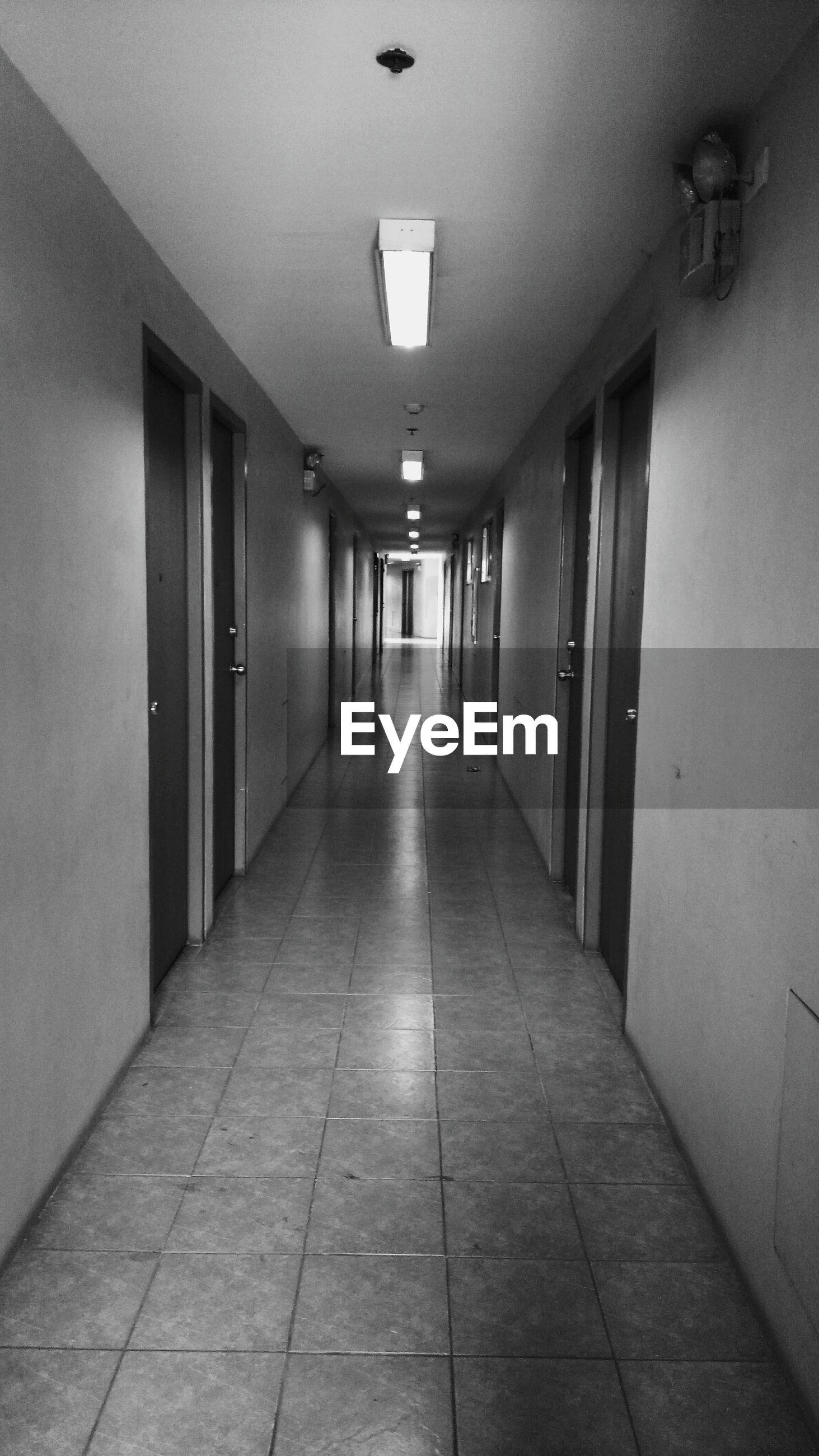 corridor, door, the way forward, tiled floor, indoors, illuminated, no people, architecture, day, police station