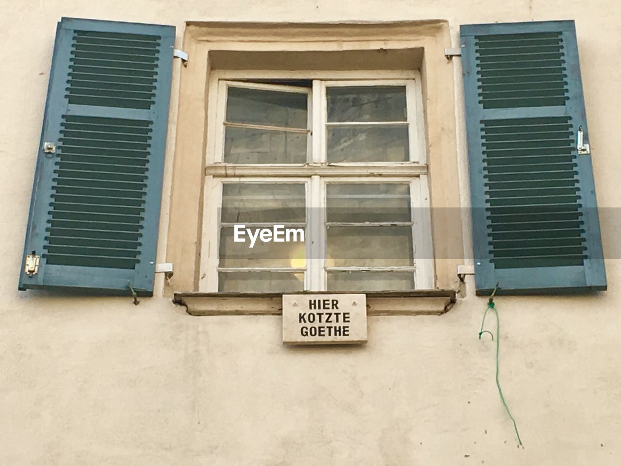 window, architecture, built structure, building exterior, building, no people, shutter, day, text, low angle view, closed, residential district, house, wall - building feature, outdoors, communication, western script, non-western script, script, sign, window frame