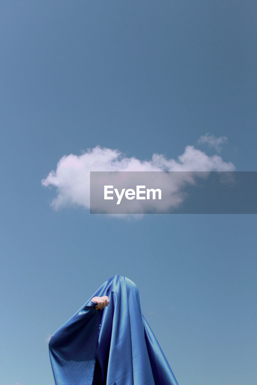 sky, cloud - sky, blue, nature, day, no people, textile, low angle view, copy space, outdoors, motion, protection, security, umbrella, beauty in nature, tranquility, sunlight, clothing, wind, close-up