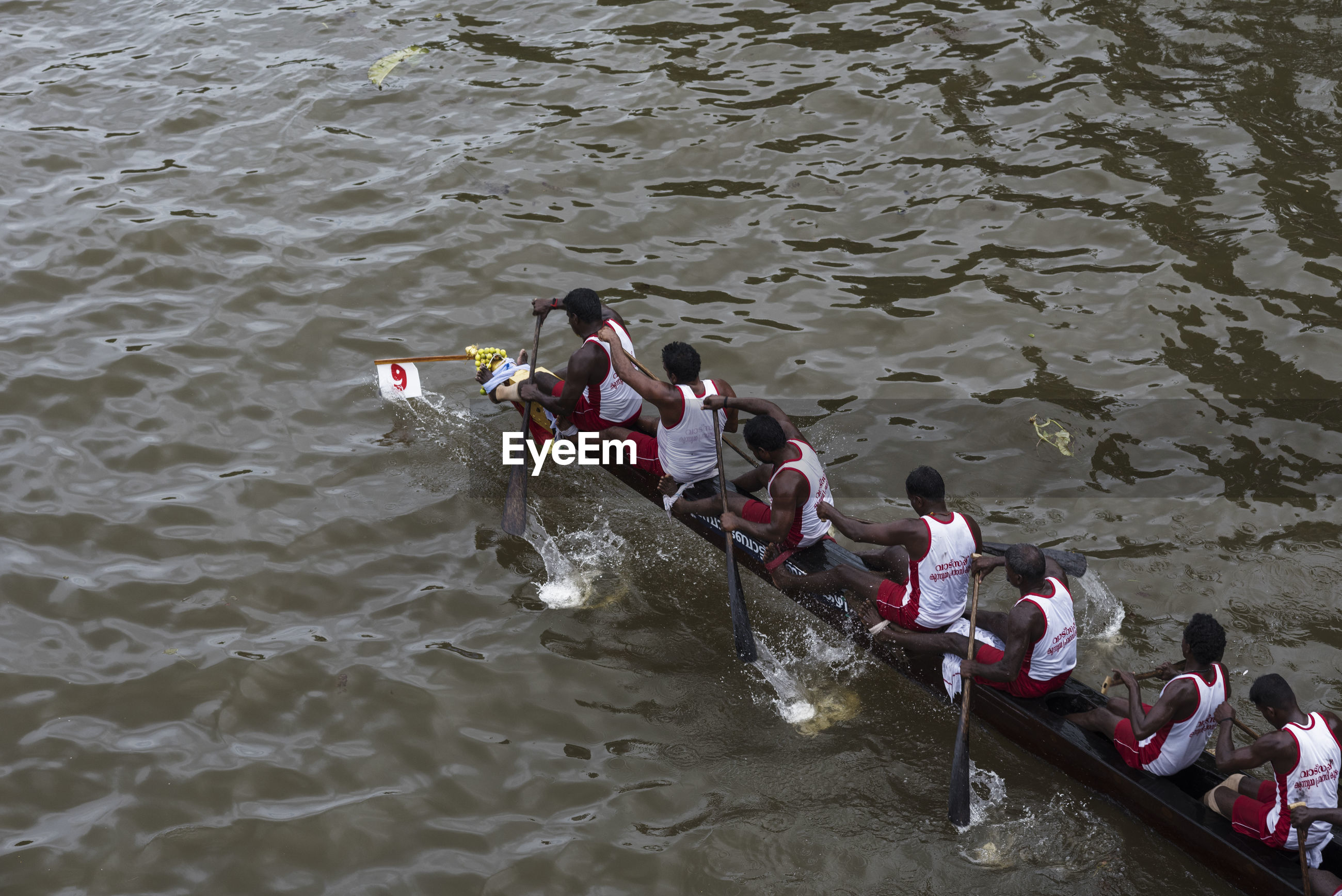 HIGH ANGLE VIEW OF PEOPLE IN RIVER