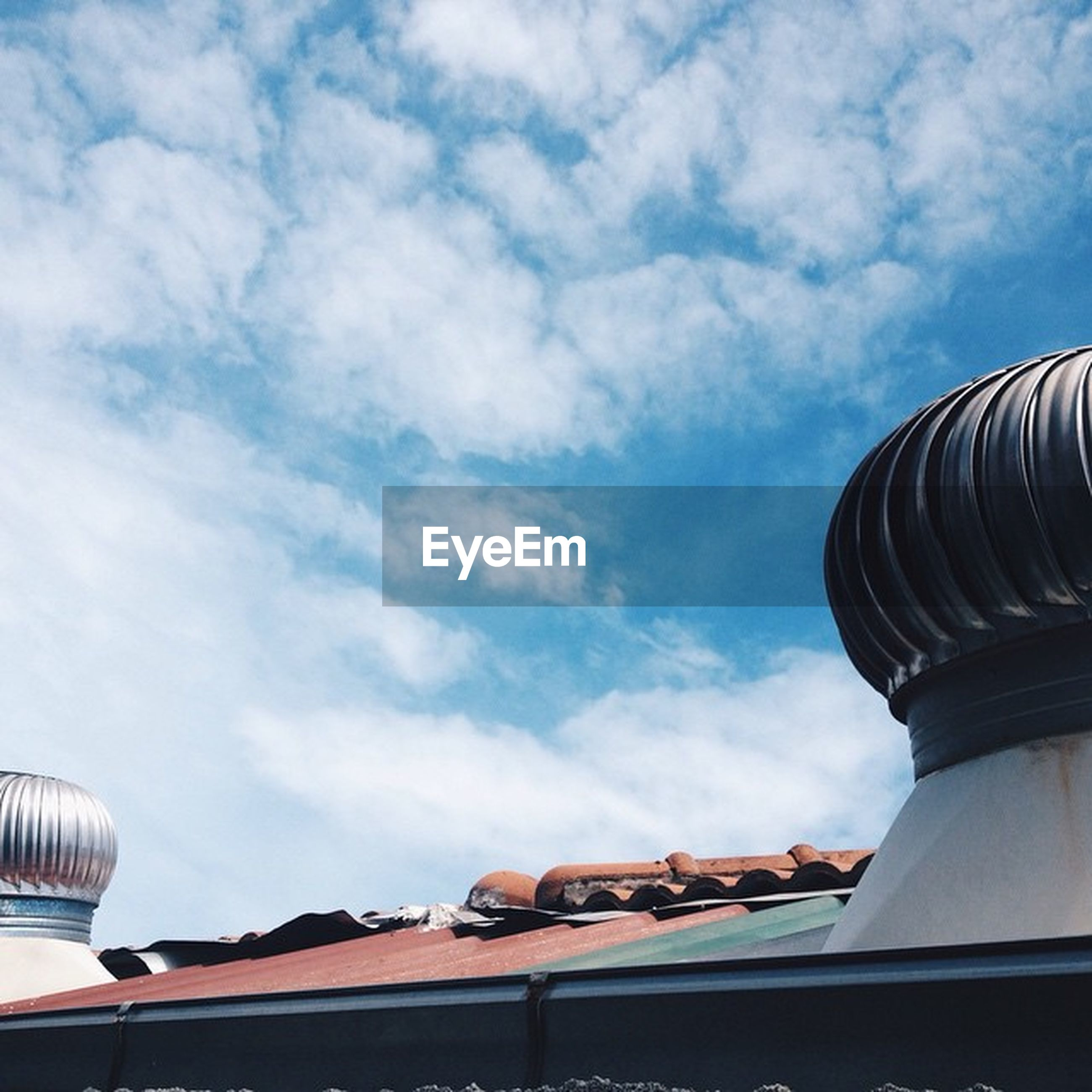 low angle view, sky, cloud - sky, built structure, cloud, cloudy, architecture, building exterior, roof, high section, day, blue, outdoors, no people, part of, pattern, nature, roof tile, building, architectural feature