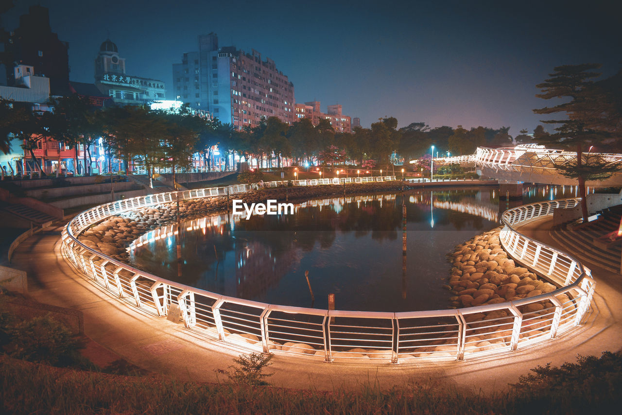 architecture, built structure, water, illuminated, building exterior, night, city, nature, reflection, transportation, connection, bridge, sky, river, no people, tree, building, bridge - man made structure, railing, outdoors, cityscape