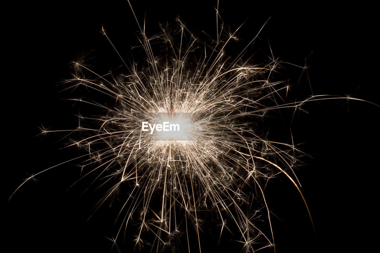 firework - man made object, firework display, night, sparks, celebration, long exposure, motion, exploding, no people, event, arts culture and entertainment, illuminated, sparkler, low angle view, black background, outdoors, firework, close-up, sky