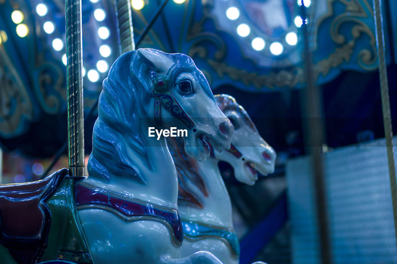 Low Angle View Of Carousel Horses At Night