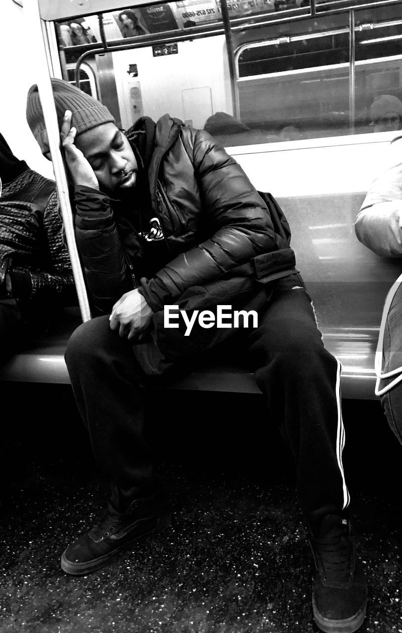 PEOPLE SITTING ON TRAIN