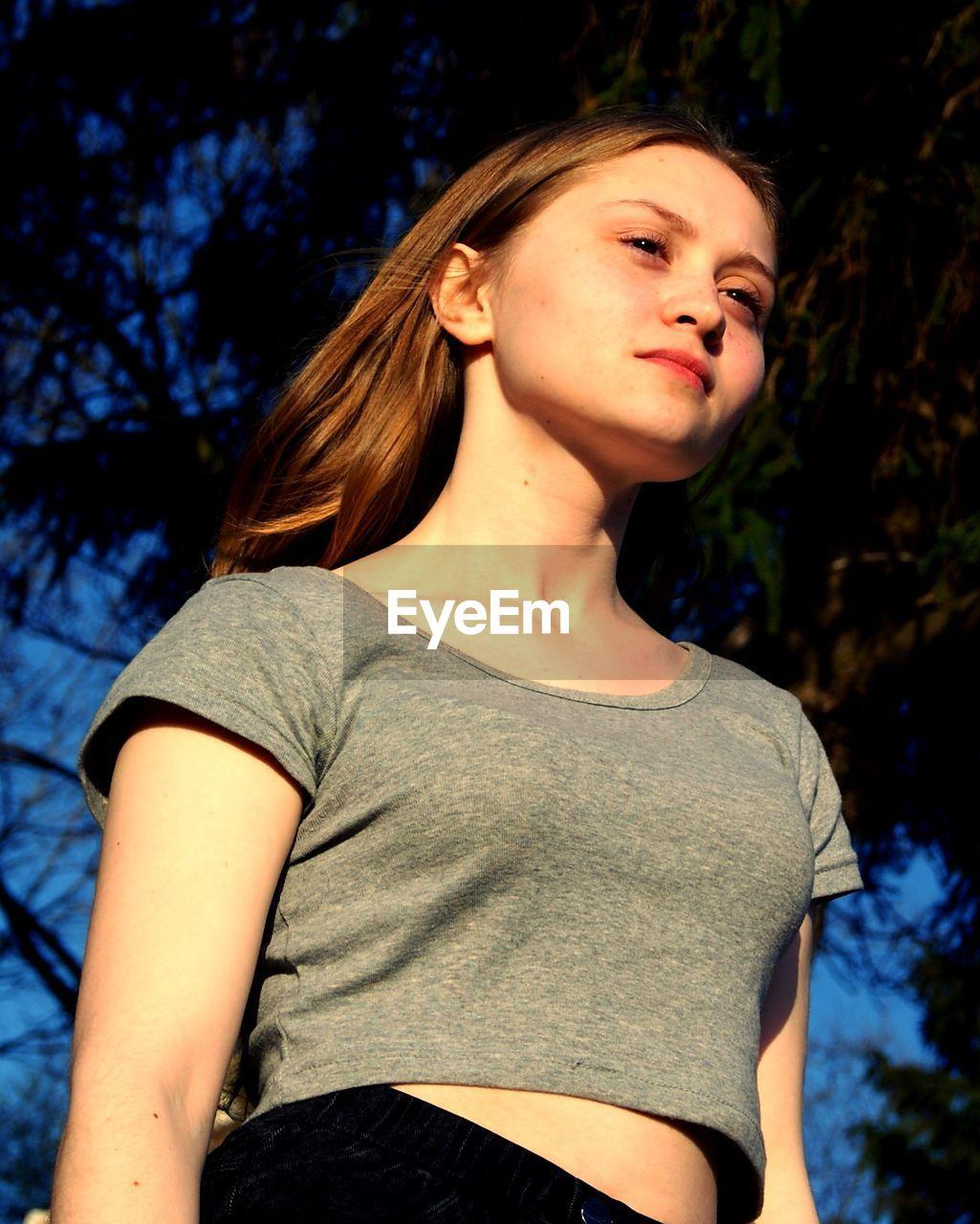 Close-up of beautiful teenage girl looking away