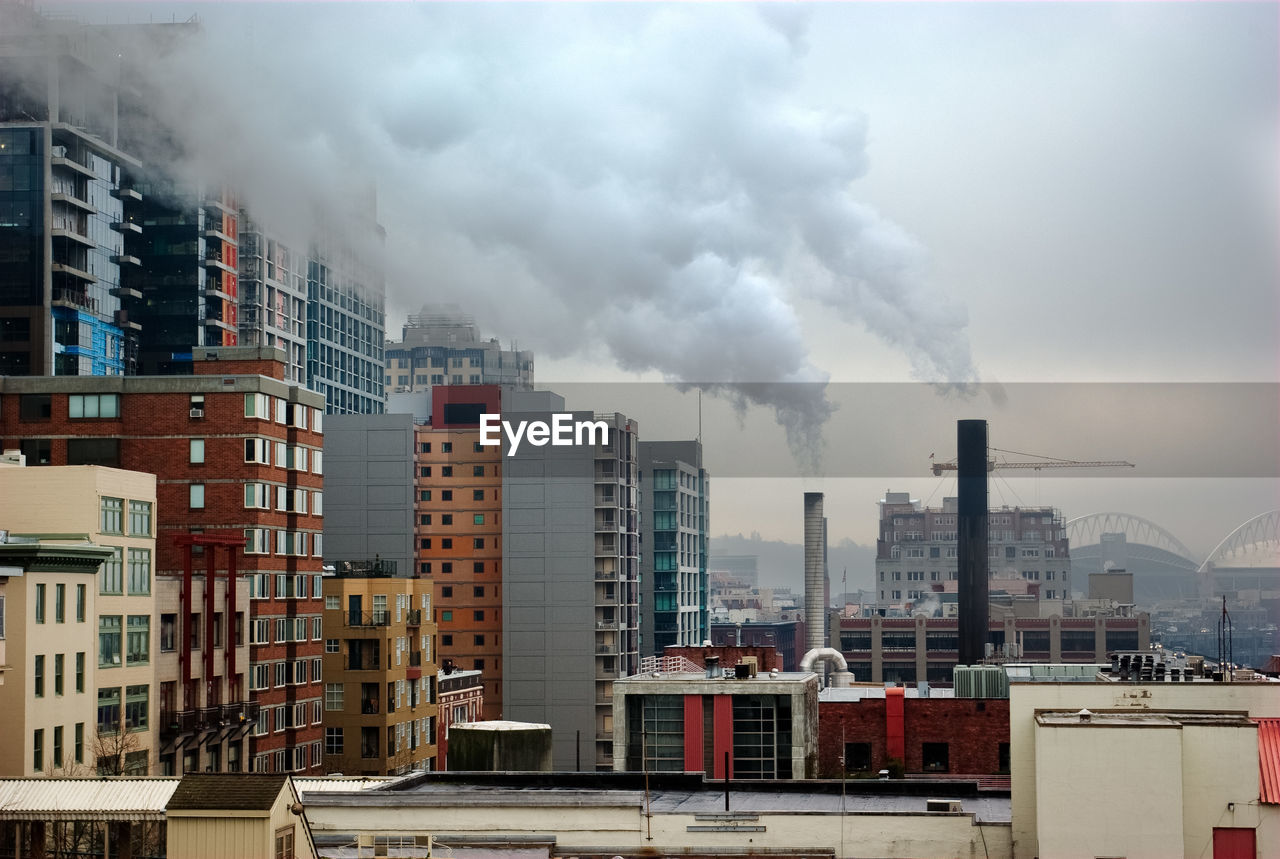 Smoke emitting from factory in city