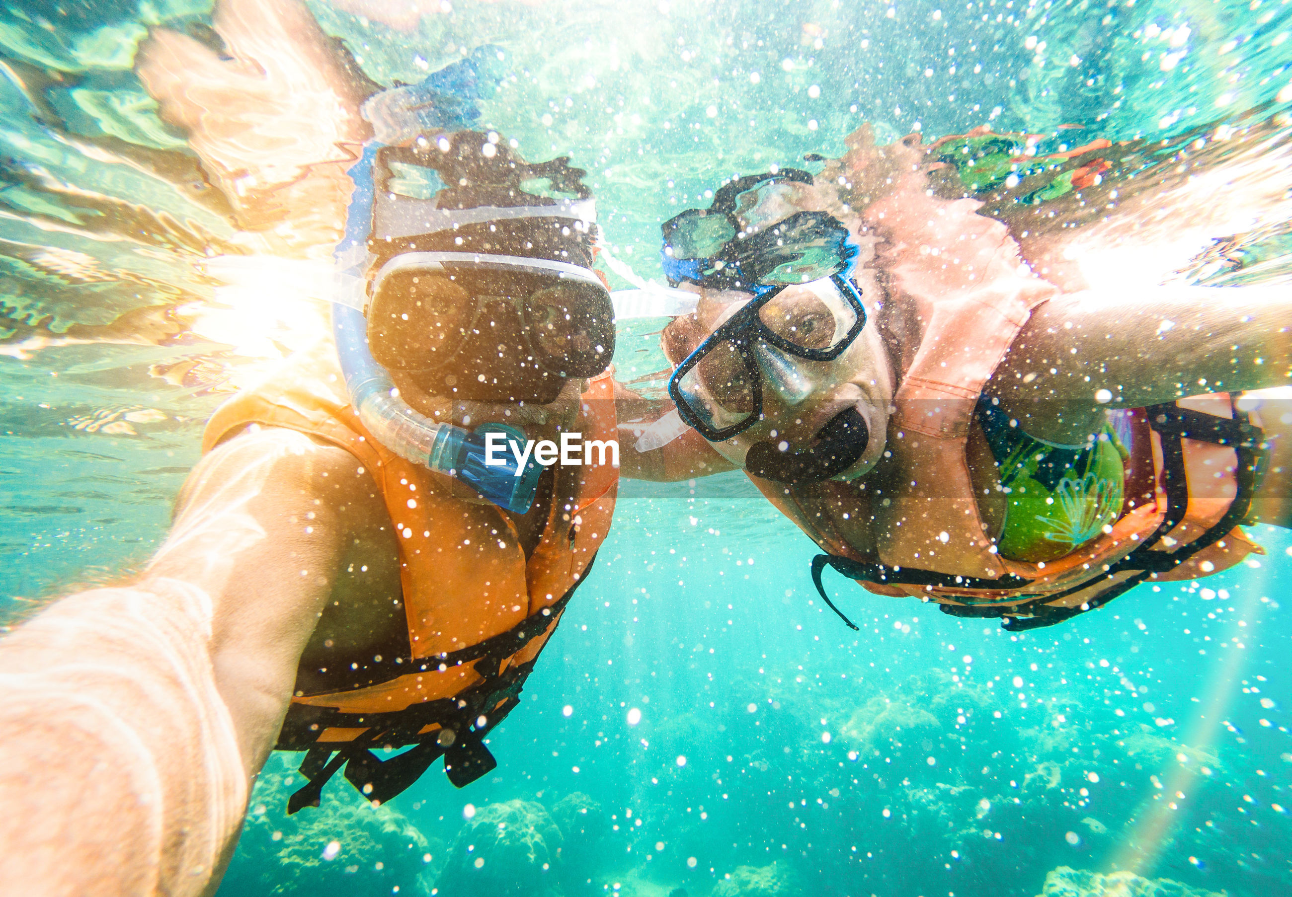 Couple snorkeling in sea