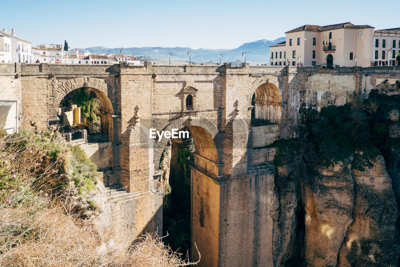 architecture, arch, connection, bridge - man made structure, built structure, day, outdoors, no people, building exterior, sky, travel destinations, mountain, nature