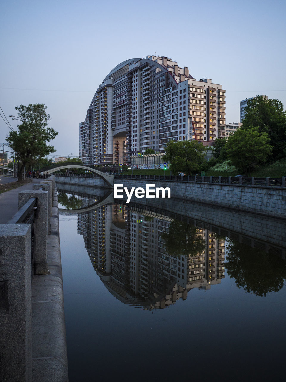 building exterior, architecture, built structure, water, reflection, waterfront, city, sky, nature, tree, building, plant, no people, river, clear sky, day, outdoors, modern, office building exterior, skyscraper