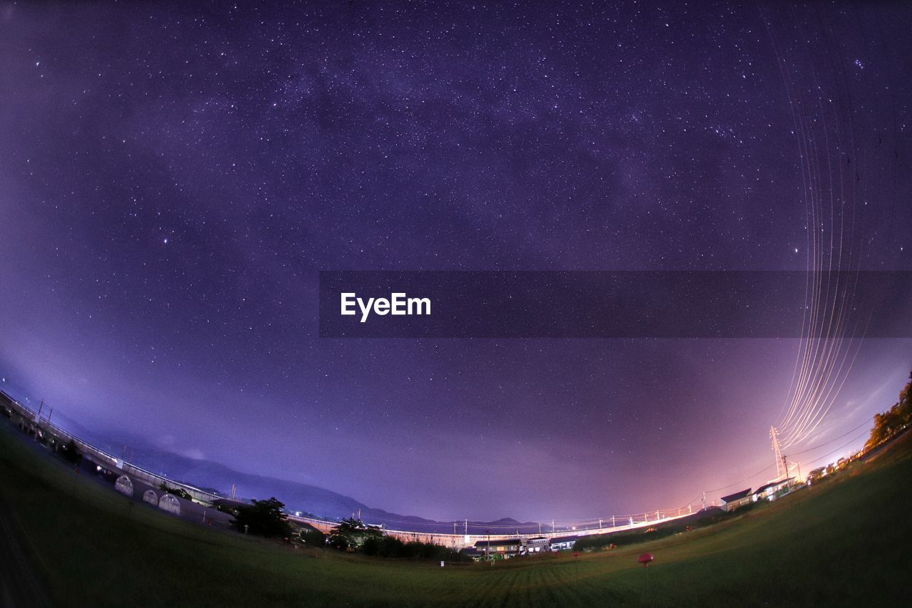 Fish-Eye View Of Field Against Sky At Night