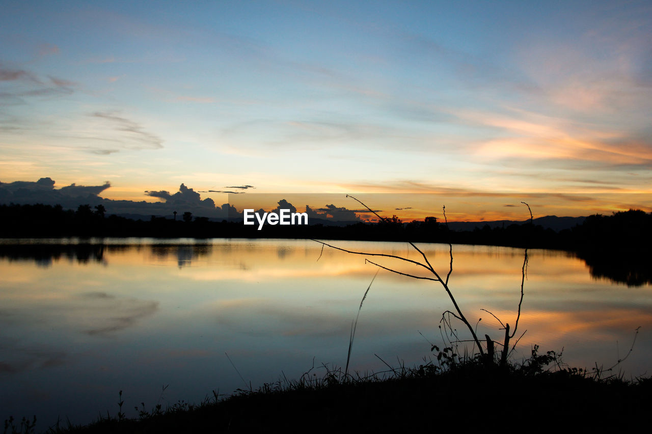 sunset, sky, scenics - nature, water, beauty in nature, cloud - sky, tranquil scene, tranquility, silhouette, lake, reflection, plant, orange color, nature, no people, idyllic, non-urban scene, outdoors, tree, romantic sky