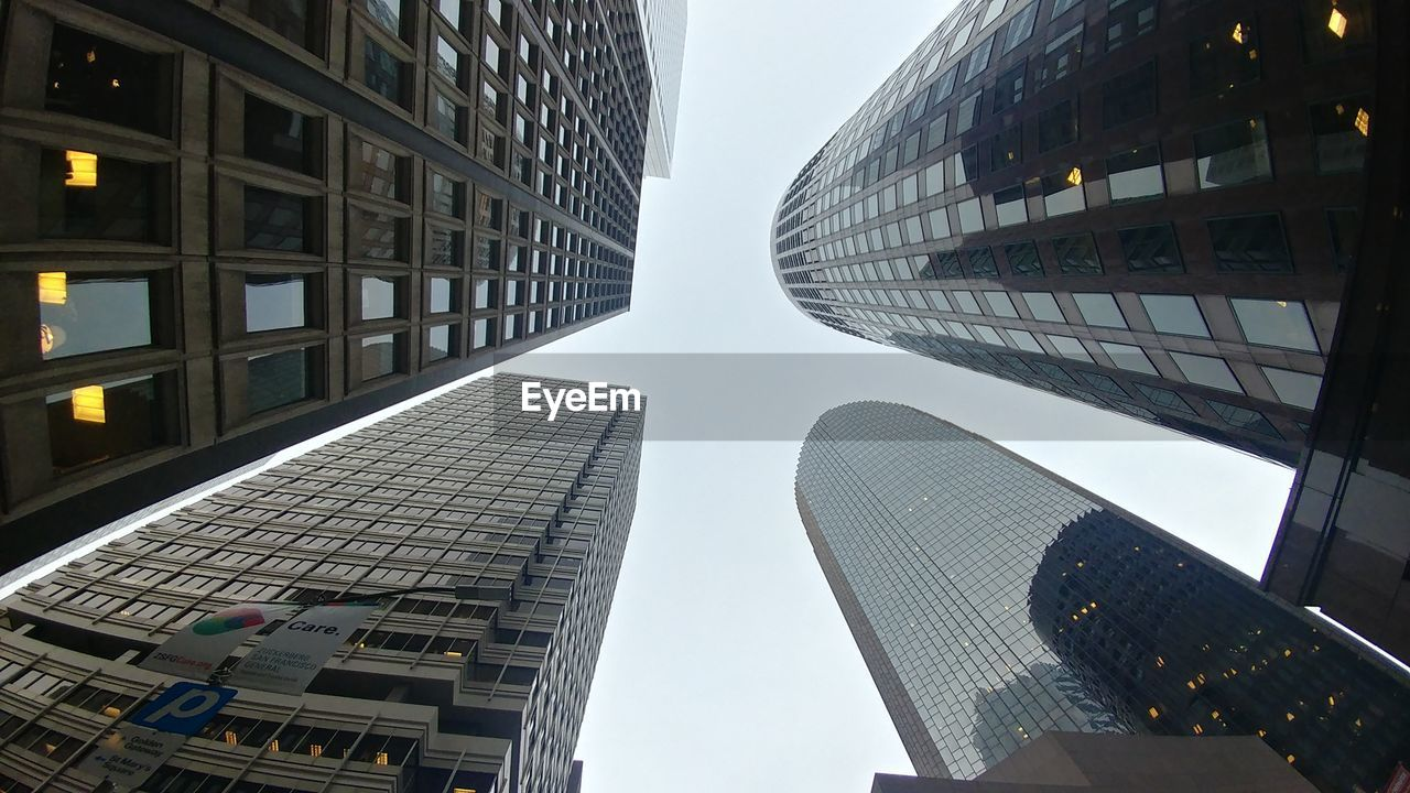 architecture, building exterior, skyscraper, built structure, city, modern, tall - high, office building, low angle view, tower, tall, outdoors, travel destinations, no people, corporate business, growth, day, office park, sky