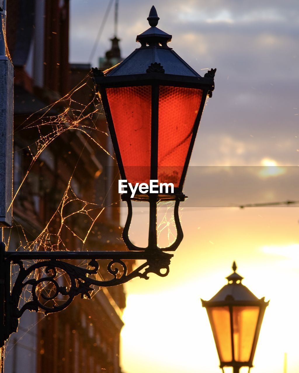 lighting equipment, street light, lantern, sky, illuminated, street, no people, focus on foreground, light, architecture, electric lamp, building exterior, electric light, nature, outdoors, gas light, low angle view, built structure, metal, electricity, antique, light fixture, electrical equipment, iron - metal, wrought iron