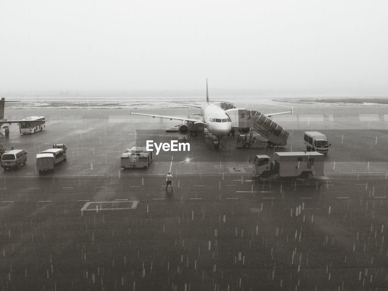 Airplane on airport runway against clear sky at monsoon