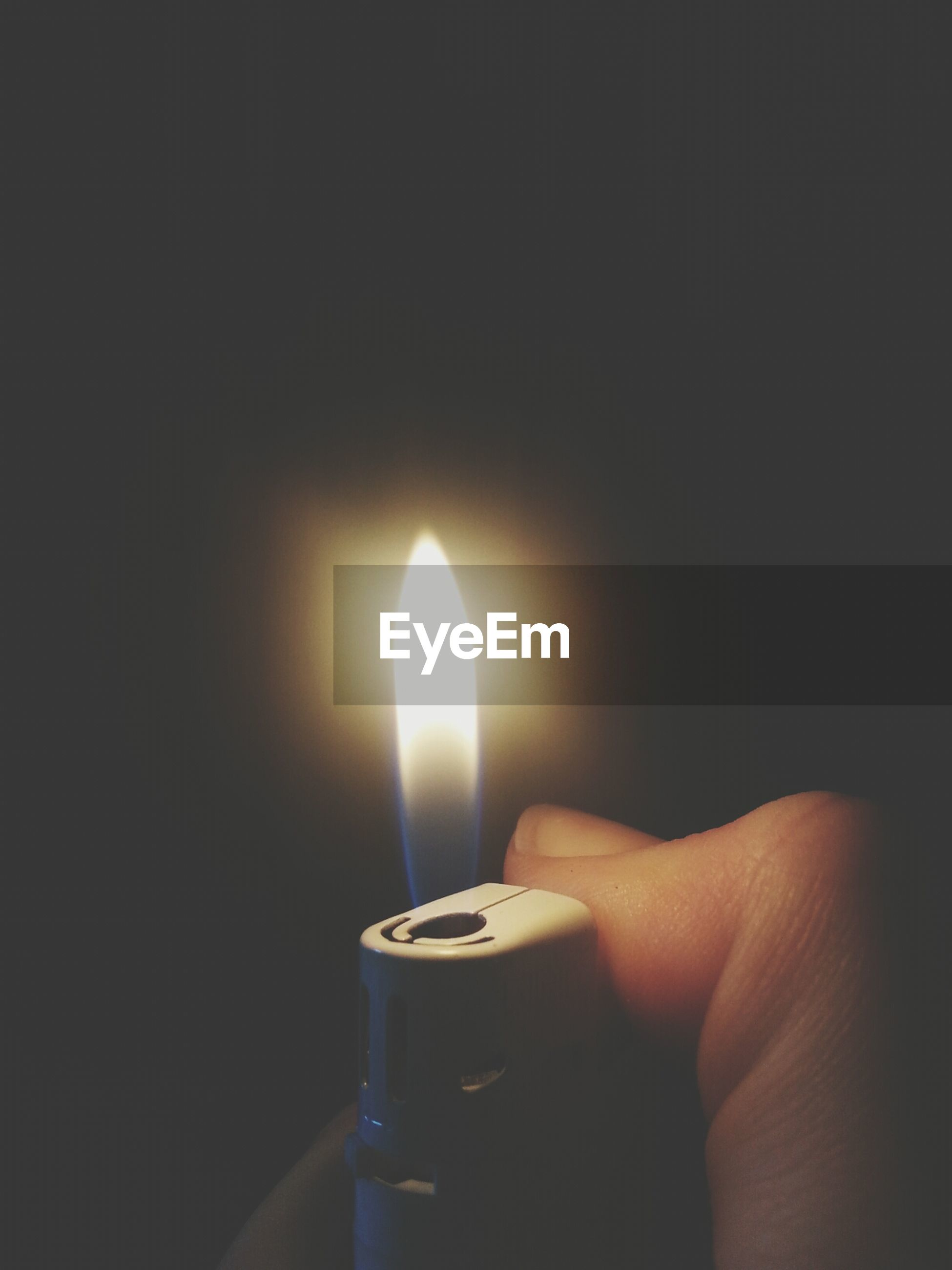 person, flame, burning, indoors, heat - temperature, part of, fire - natural phenomenon, human finger, candle, glowing, close-up, lit, holding, illuminated, cropped, copy space, unrecognizable person