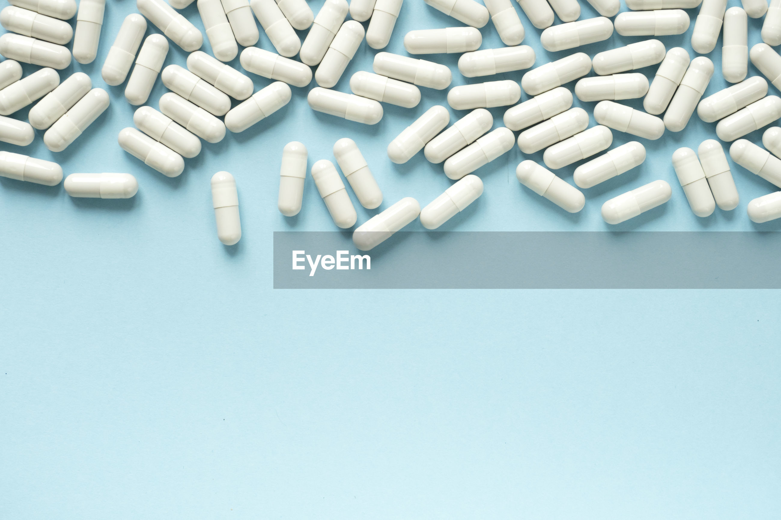 High angle view of pills  on blue background