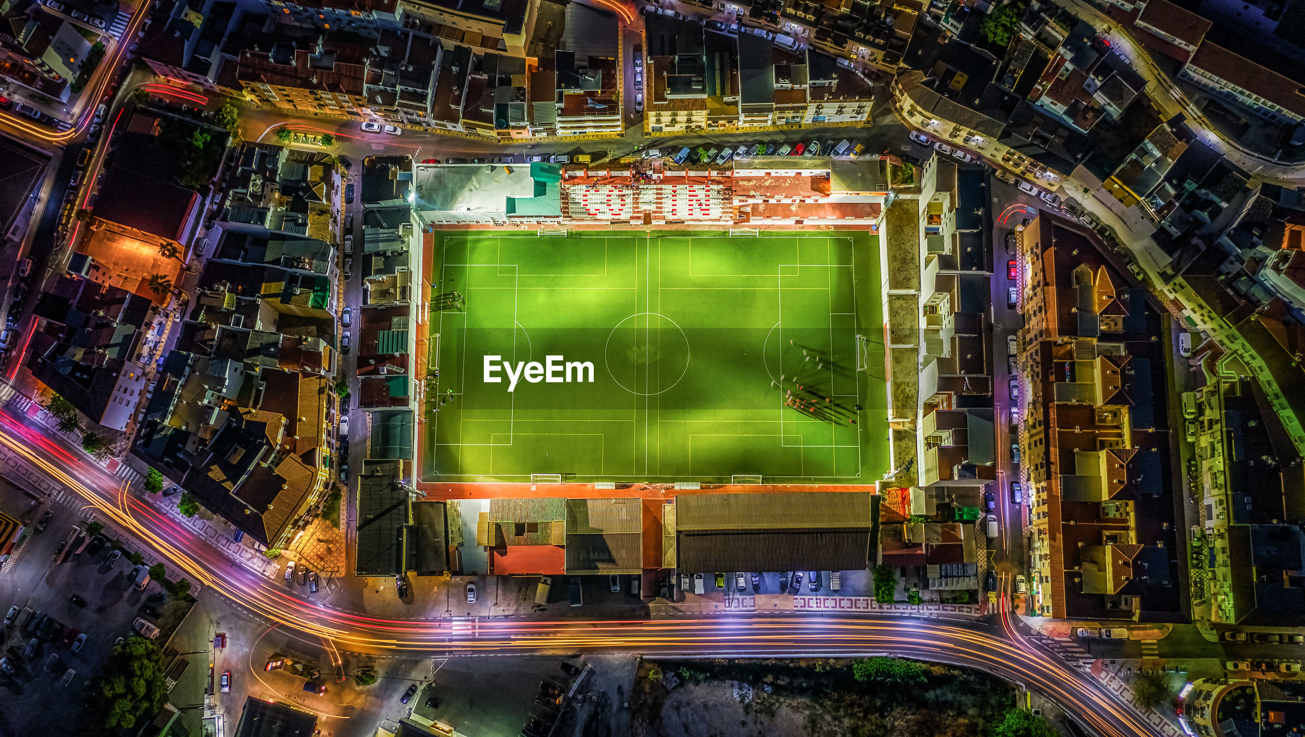 Aerial view of soccer field in city at night