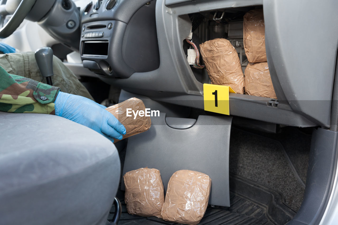Midsection Of Person Sitting In Car