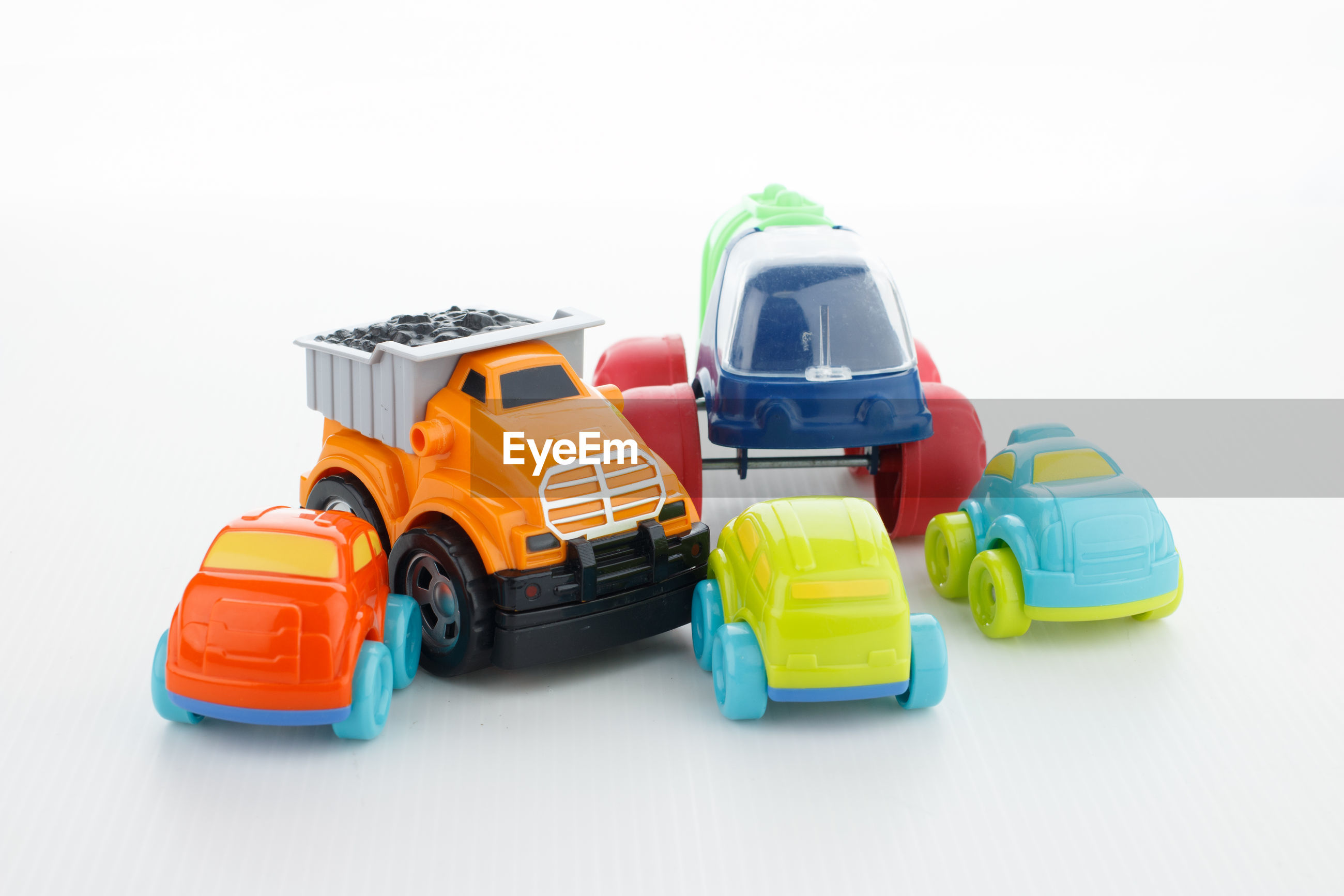 Close-up of toy cars against white background