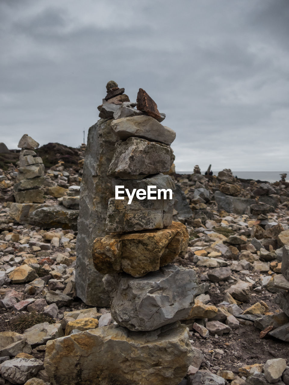 solid, rock, balance, stone - object, sky, stack, rock - object, cloud - sky, no people, stone, nature, day, land, outdoors, tranquility, history, focus on foreground, zen-like, tranquil scene, mountain, pebble