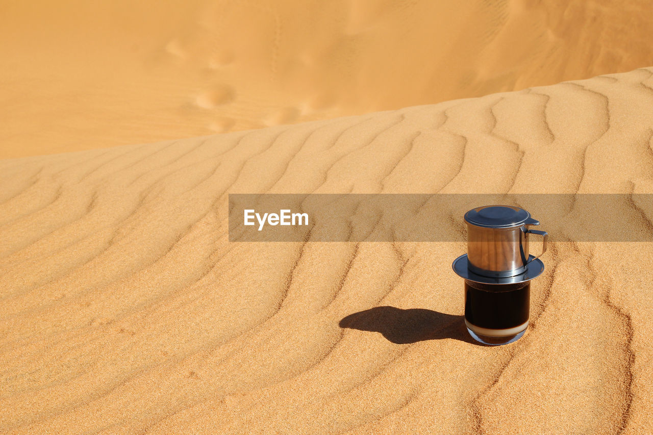 sand, land, nature, sand dune, desert, container, sunlight, indoors, people, beach, brown, climate, arid climate, high angle view, beige, landscape, towel, heat - temperature, environment