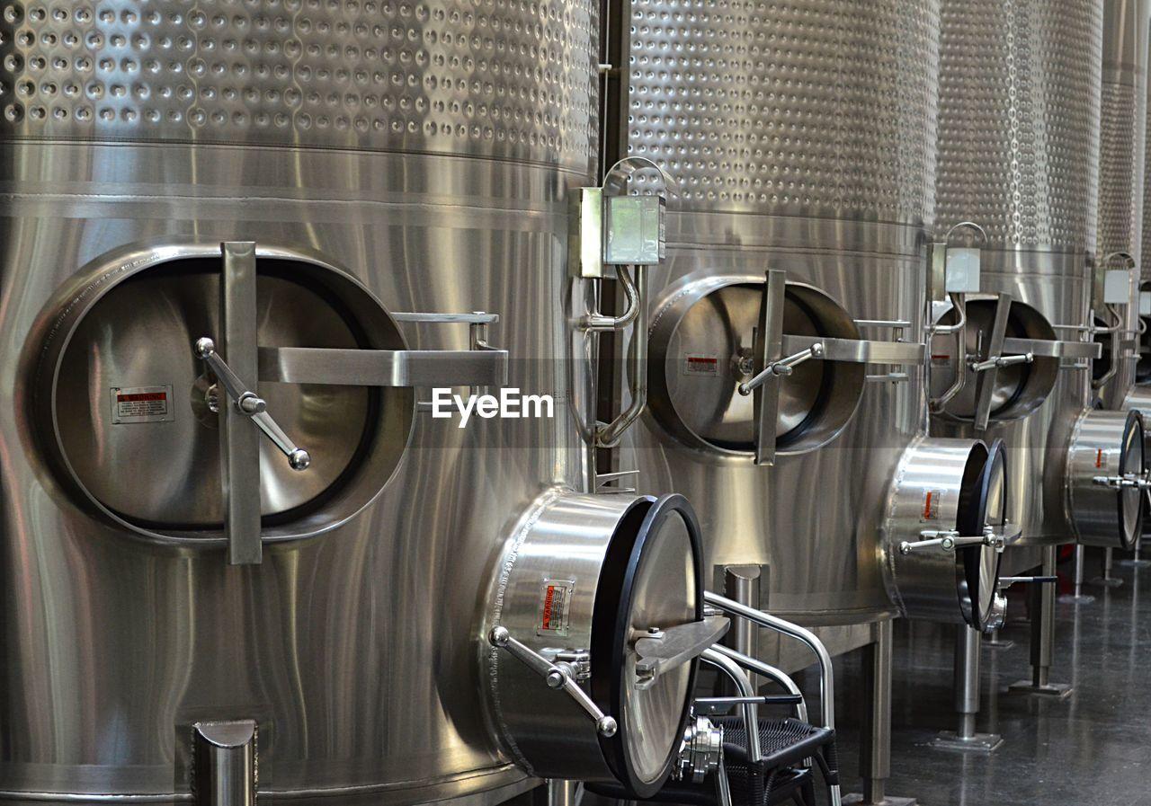 Close-Up Of Distillery Stills At Factory