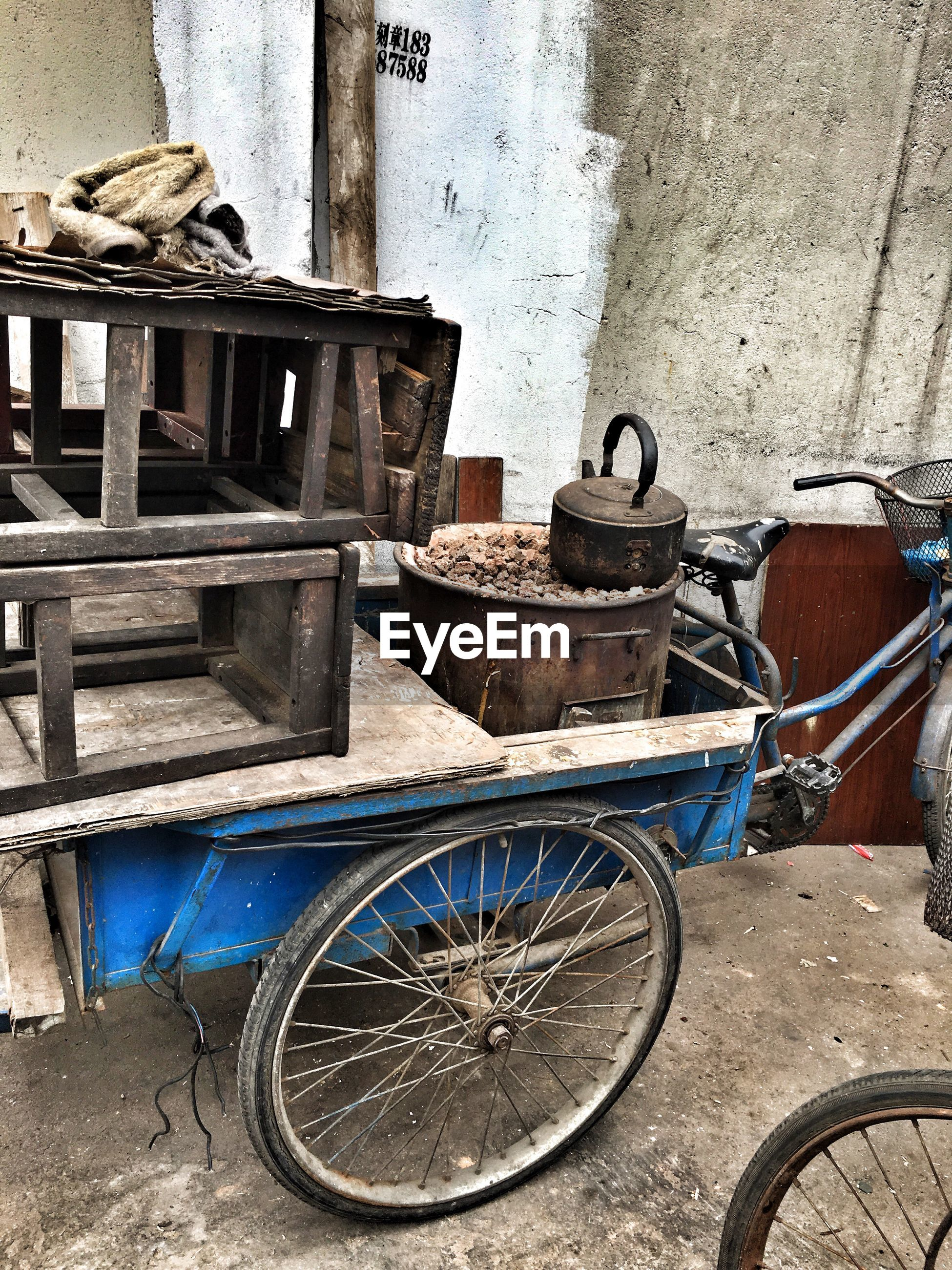 Old stools and teapot on tricycle