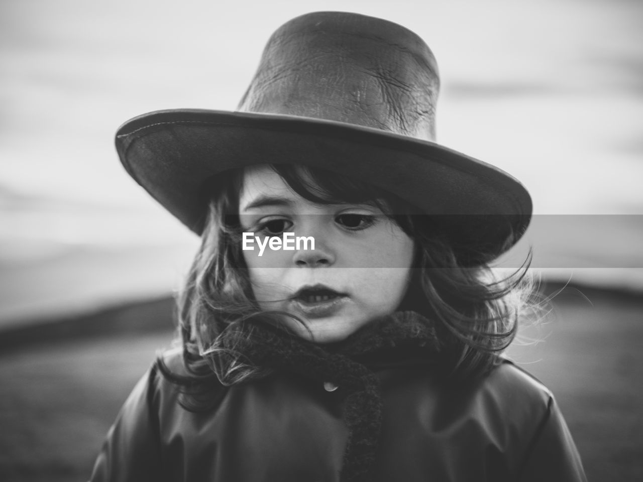 hat, portrait, clothing, one person, childhood, child, real people, front view, headshot, focus on foreground, leisure activity, lifestyles, close-up, day, looking at camera, innocence, women, human face