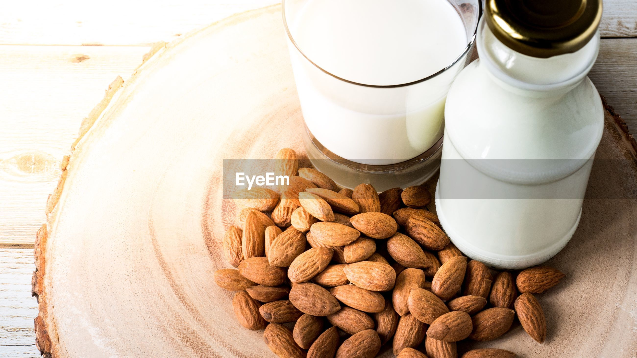 High angle view of almonds with milk on table