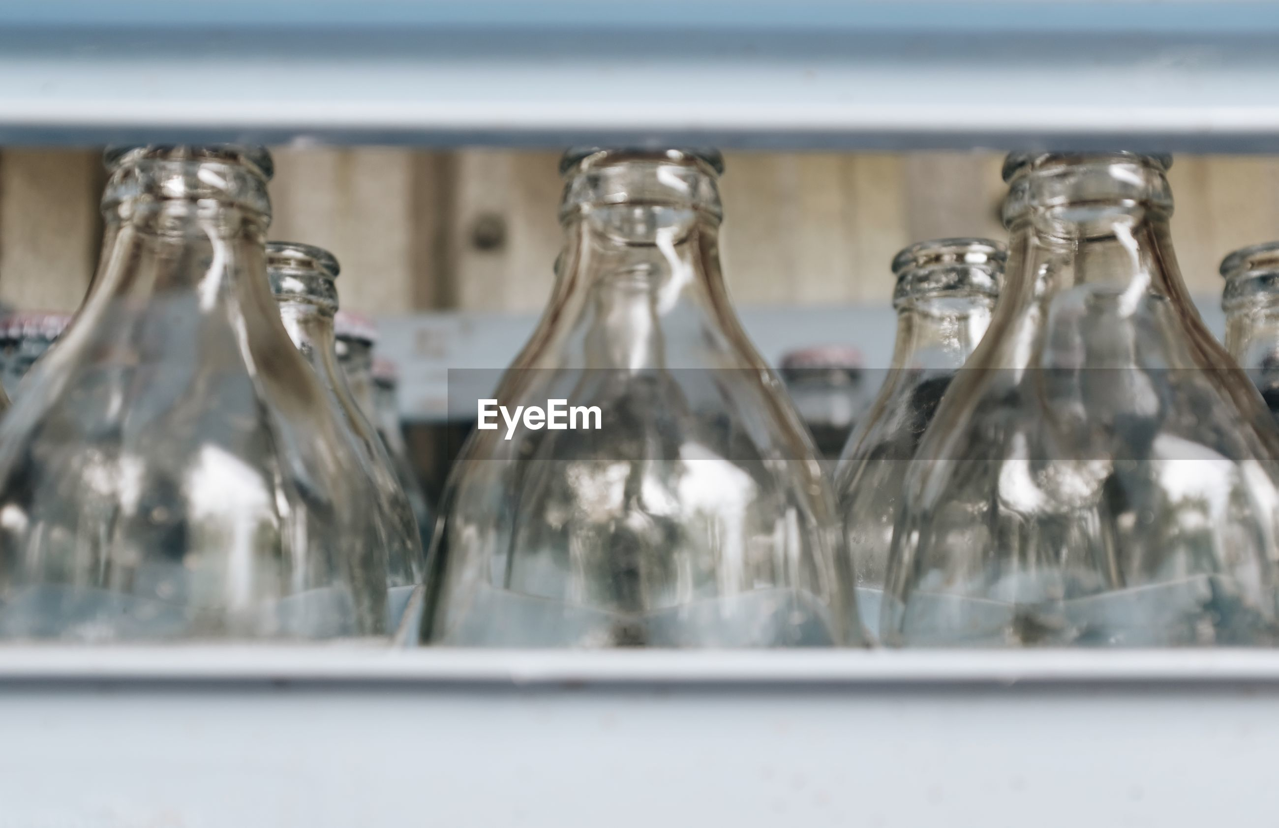 A close up shot of a glass bottle in the bottle cage