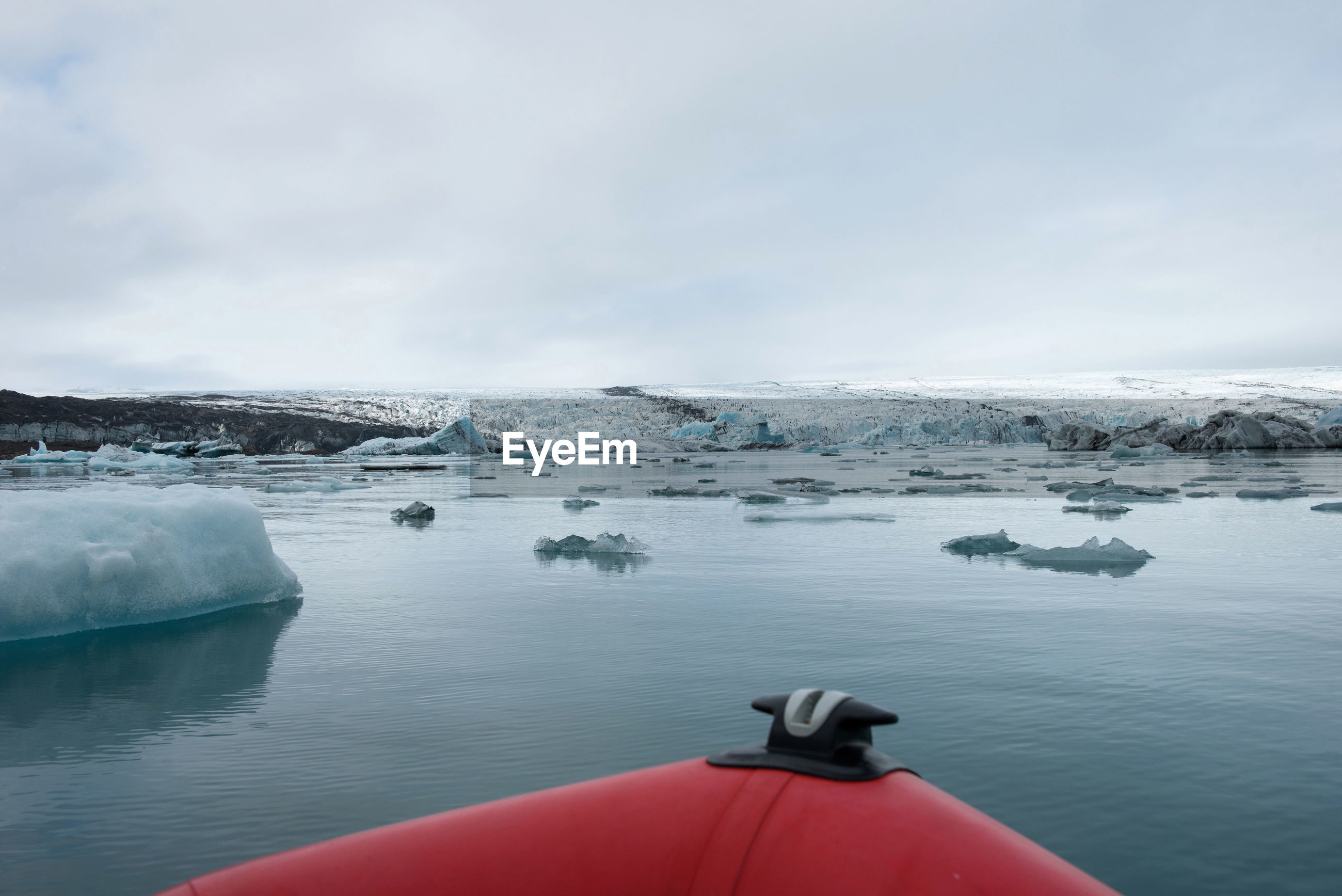 Scenic view of frozen sea seen from boat against sky