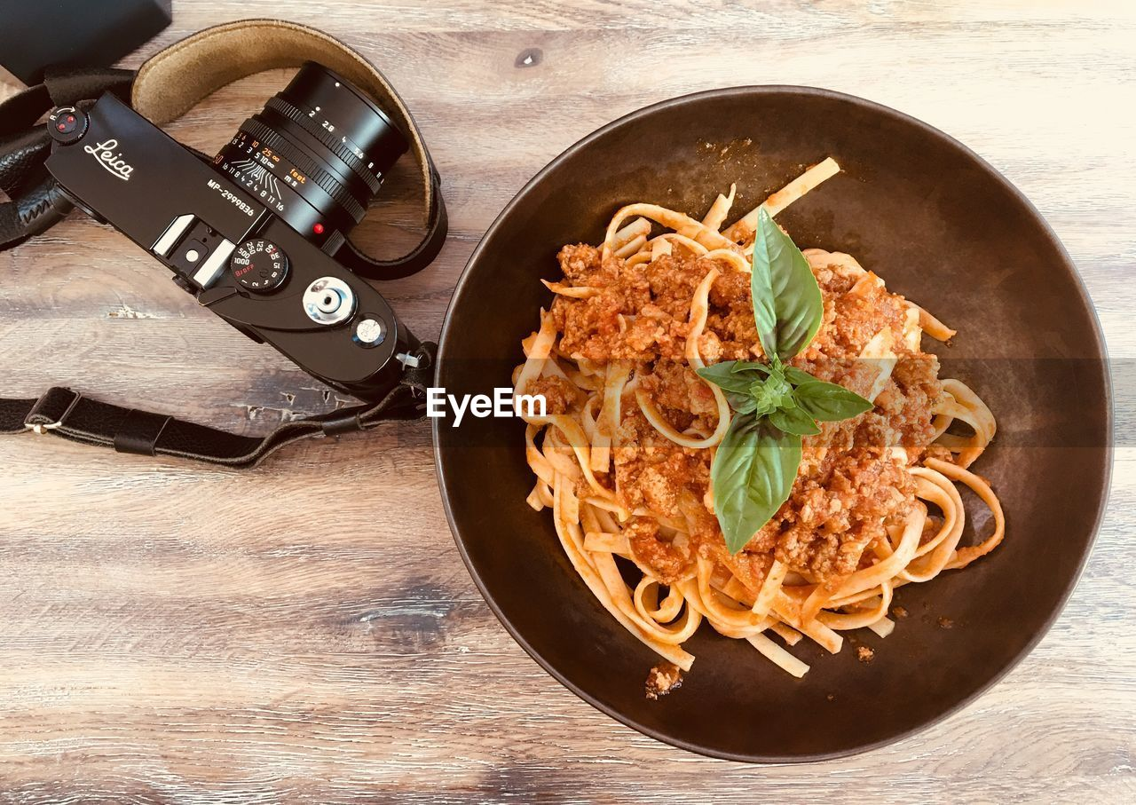 table, still life, indoors, no people, high angle view, wood - material, food and drink, old-fashioned, plate, bowl, food, ready-to-eat, close-up, freshness, day