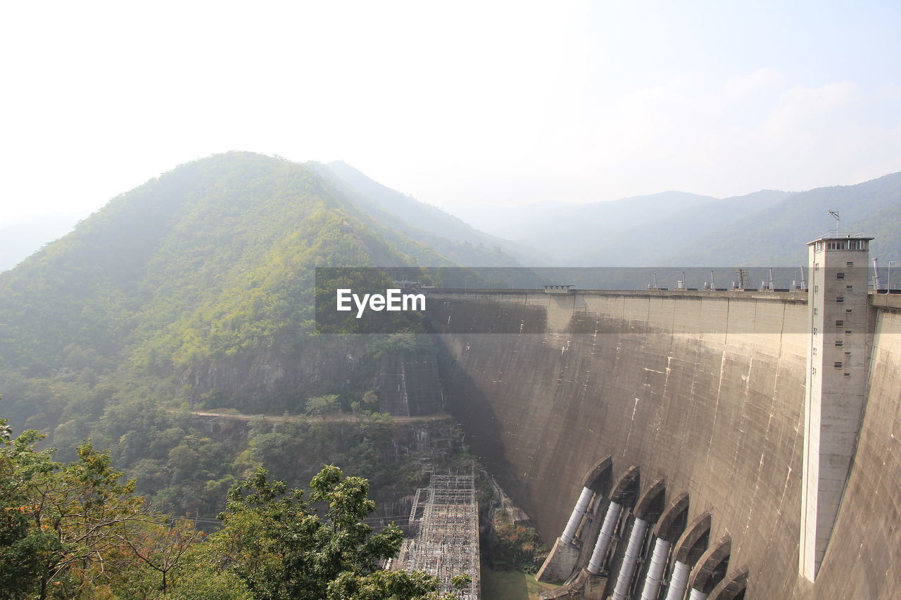 mountain, nature, sky, architecture, scenics - nature, mountain range, built structure, day, beauty in nature, no people, environment, hydroelectric power, dam, tree, plant, tranquil scene, building exterior, renewable energy, landscape, tranquility, outdoors