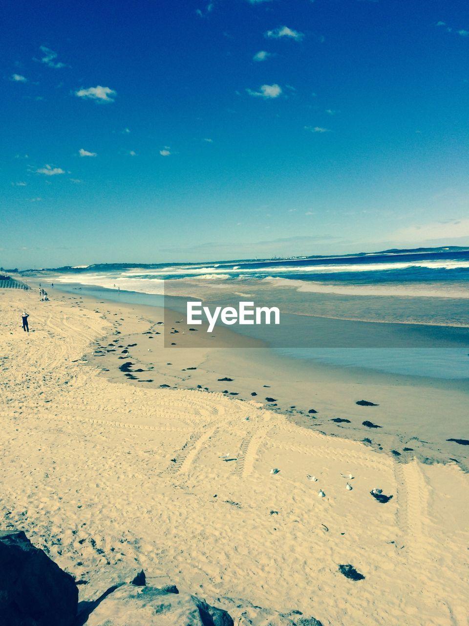 Sandy coastline on clear day