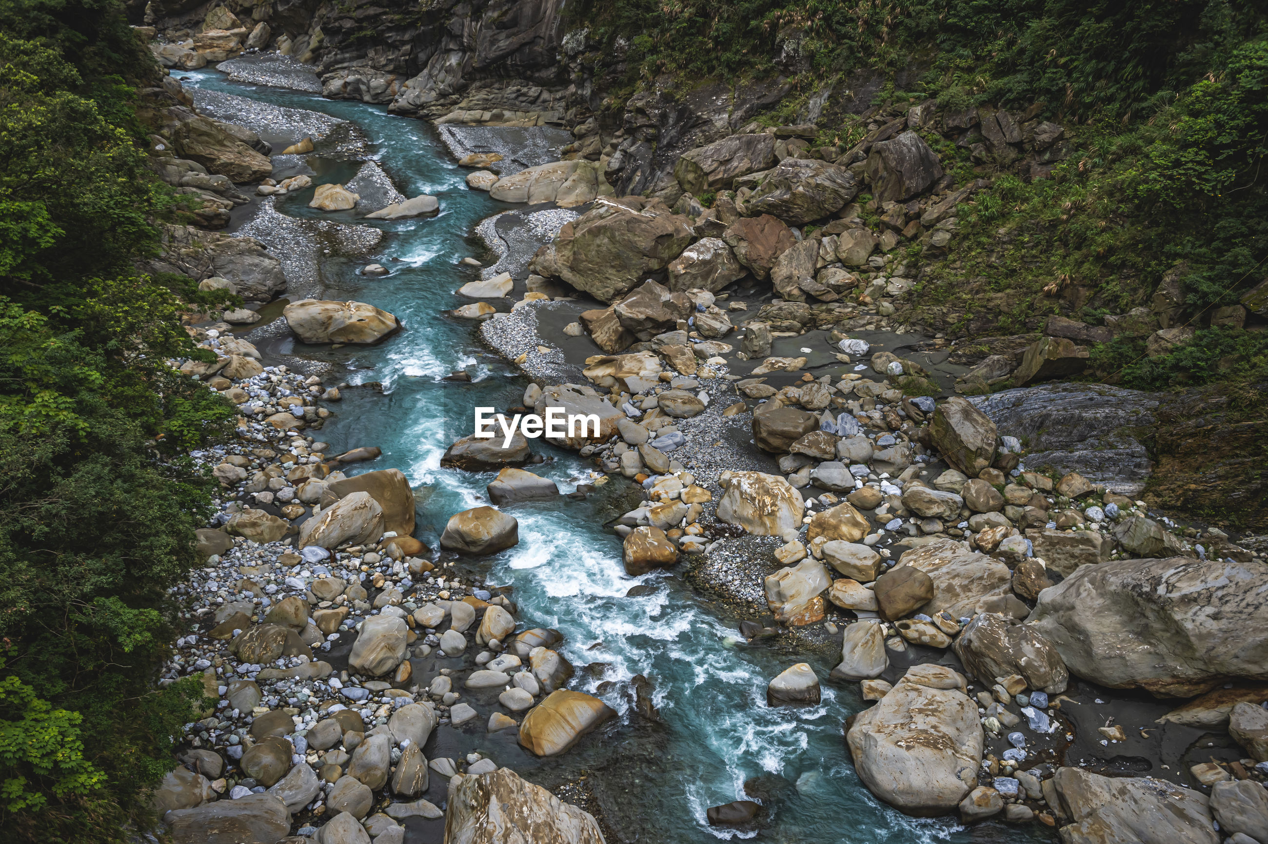 High angle view of stones in river