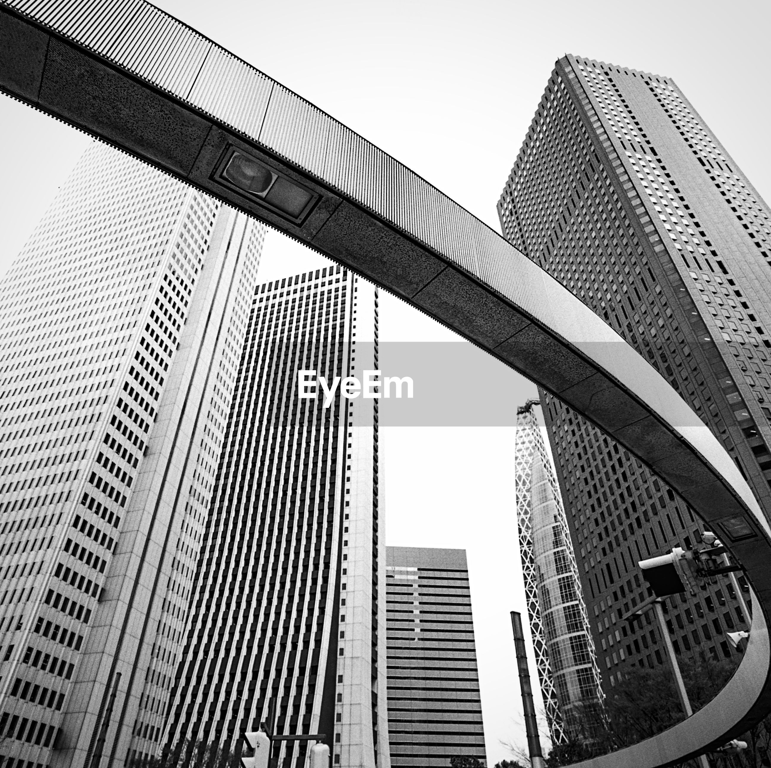 architecture, built structure, building exterior, skyscraper, city, modern, office building, tall - high, low angle view, clear sky, tower, building, capital cities, sky, financial district, glass - material, reflection, day, city life, tall