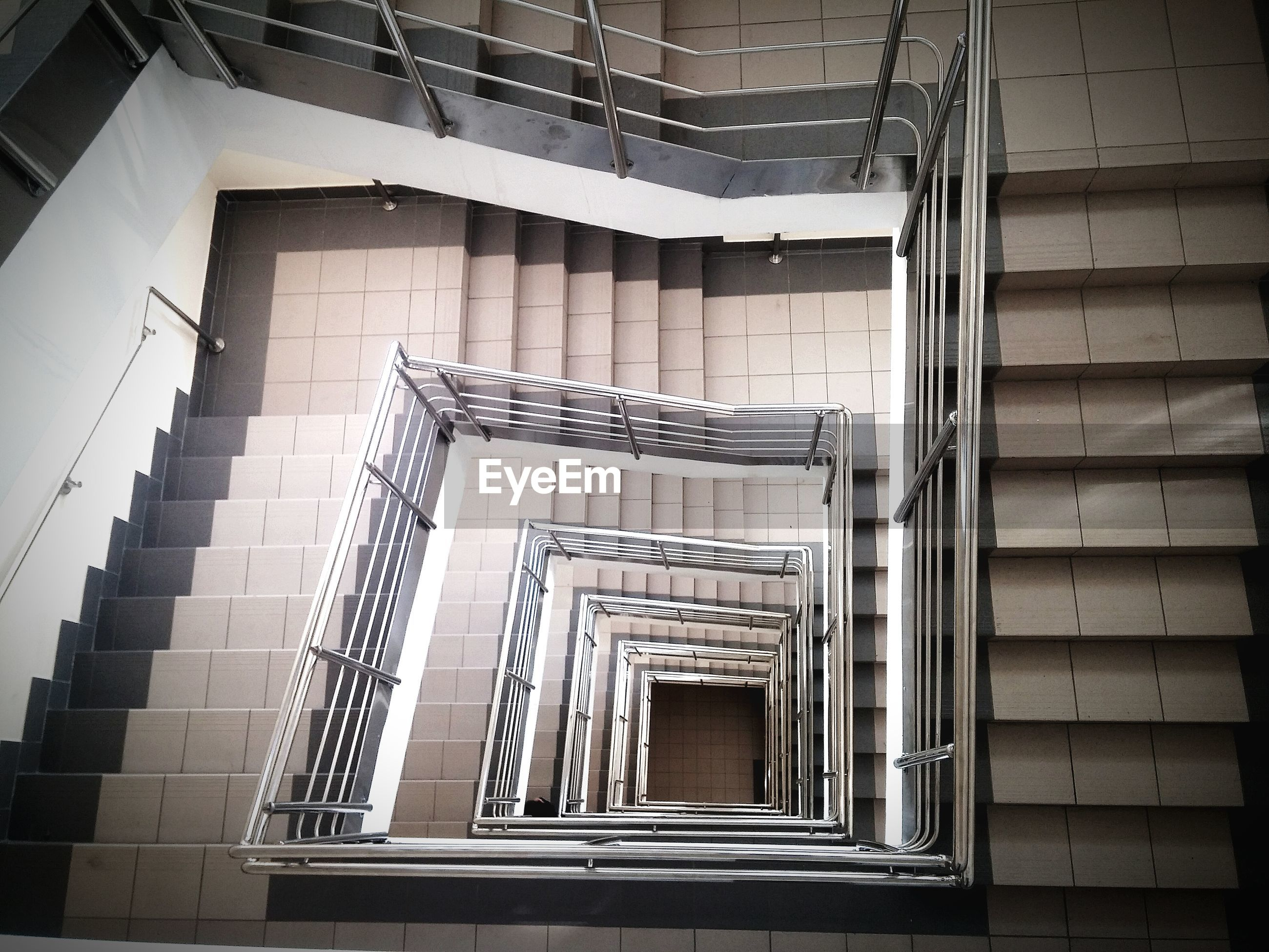 architecture, built structure, staircase, steps and staircases, steps, building exterior, railing, low angle view, building, indoors, pattern, spiral staircase, spiral, stairs, no people, house, design, directly below, metal, day