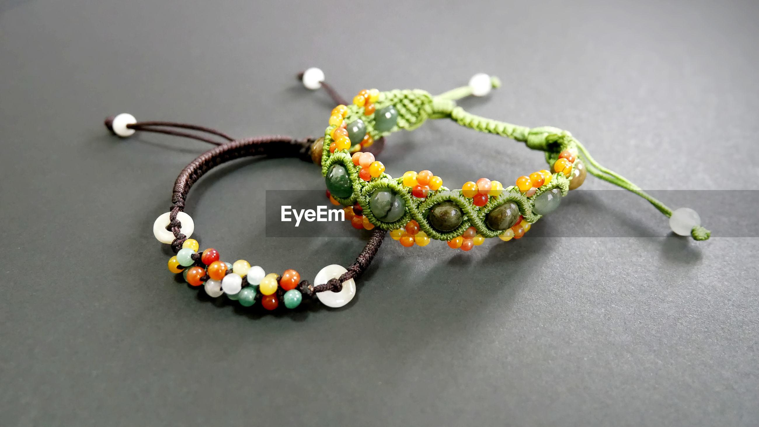 Close-up of bracelets on table