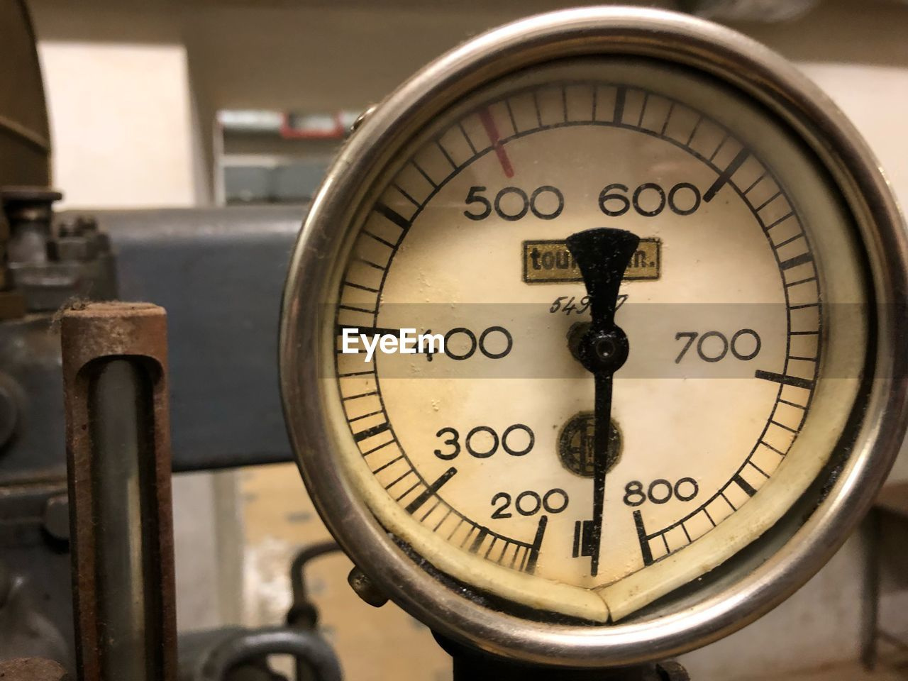 Close-up of pressure gauge in factory