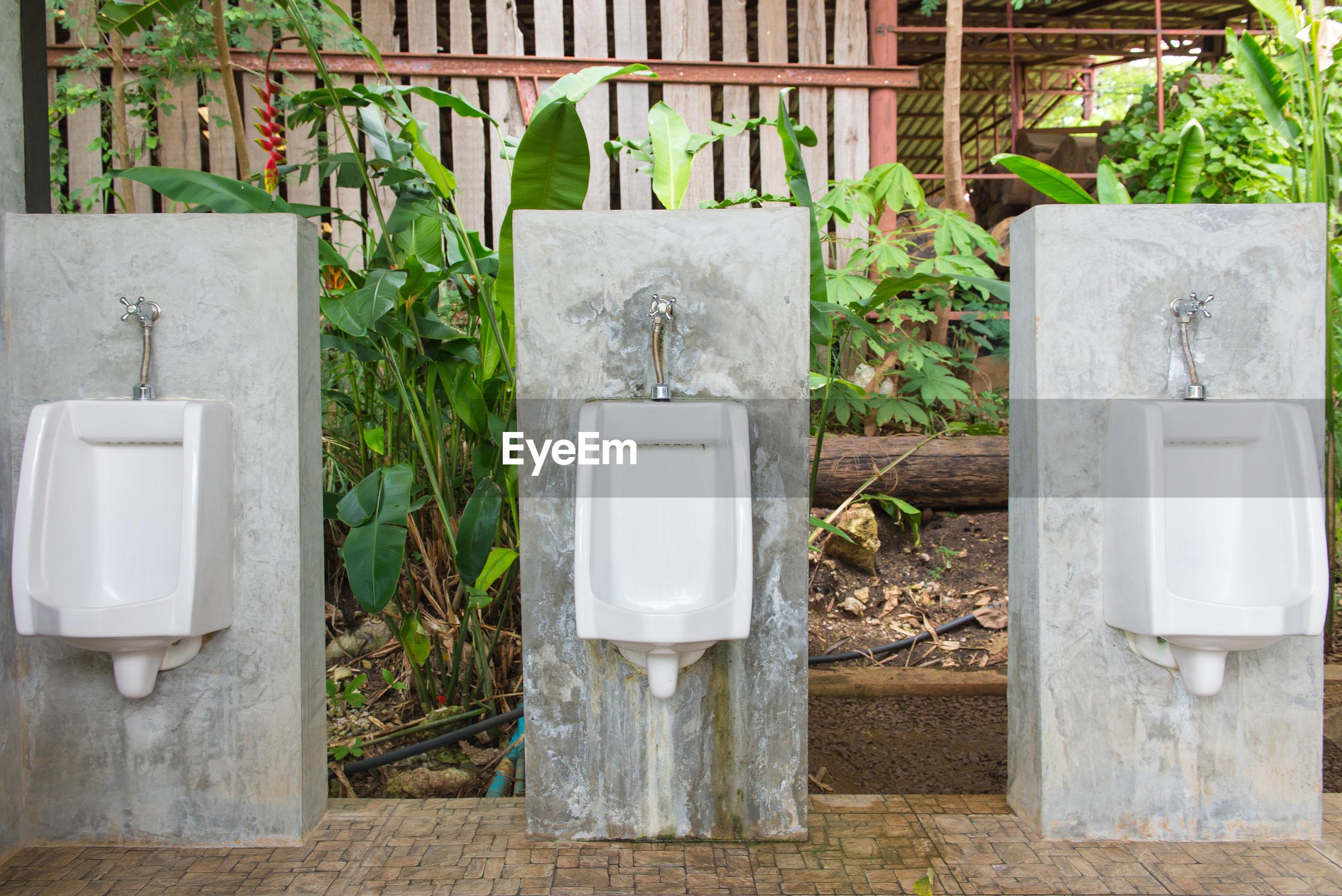 Urinals on concrete blocks outdoors