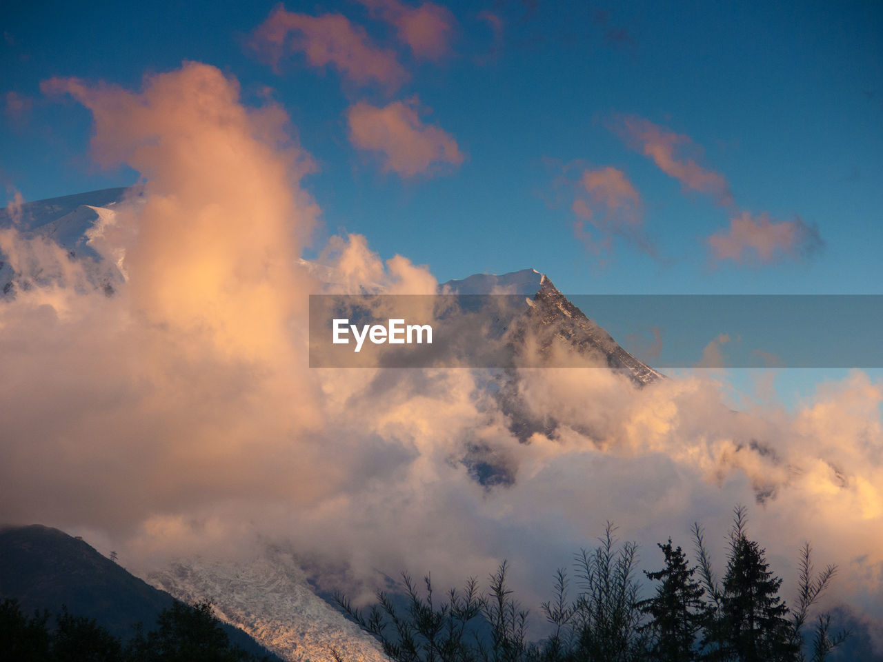 sky, cloud - sky, nature, beauty in nature, no people, low angle view, outdoors, mountain, scenics, tranquility, tranquil scene, day, tree