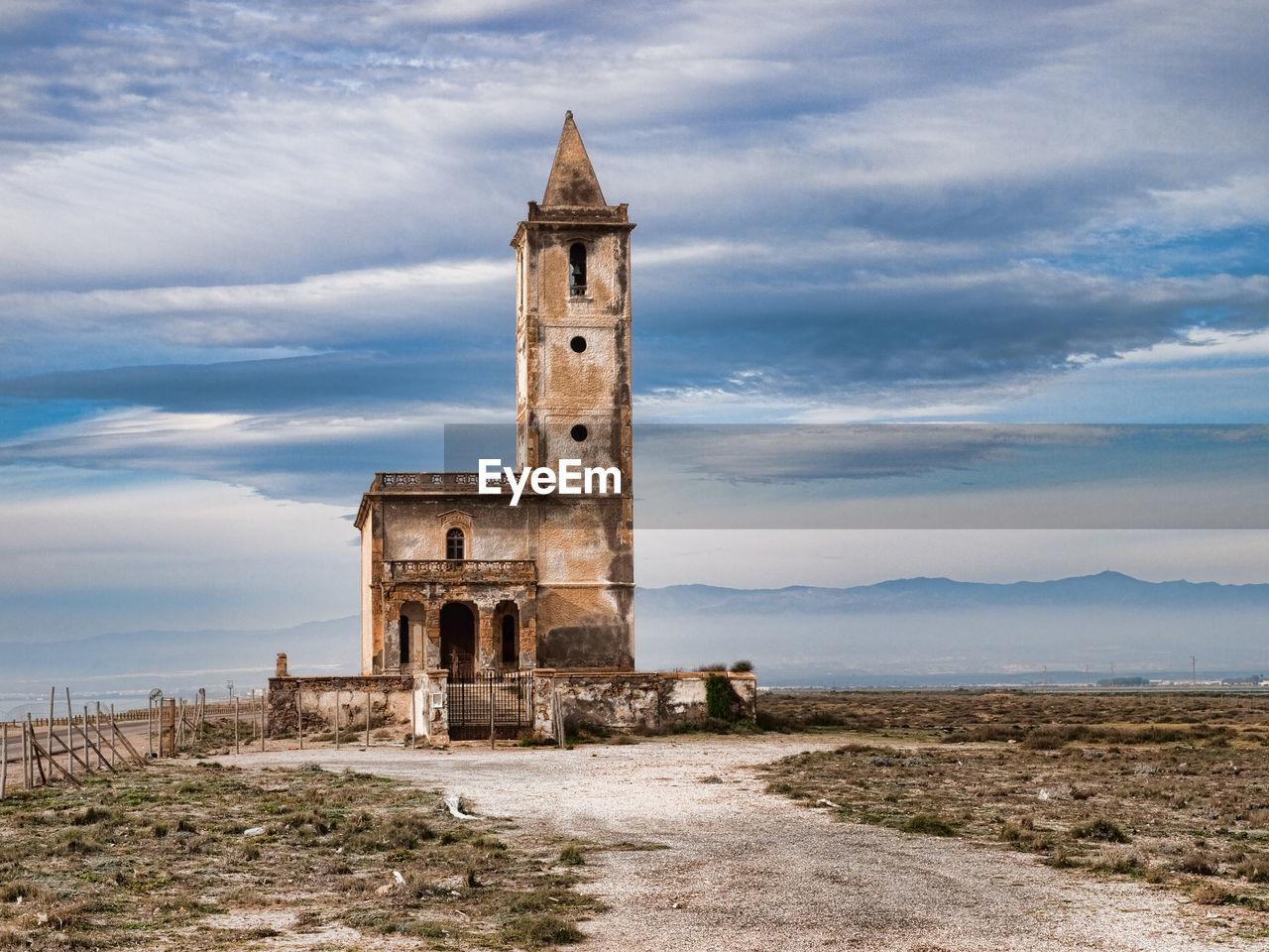 Old church at cabo de gata against cloudy sky